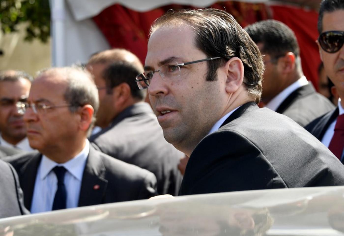 L'actuel Premier ministre Youcef Chahed, candidat à l'élection présidentielle, ne compte pas démissionner de son poste à la tête du gouvernement pendant la campagne électorale (AFP)