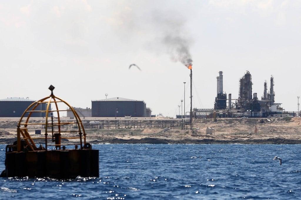 In Zawiya, western Libya's only oil refinery, about 50km outside of Tripoli (AFP)