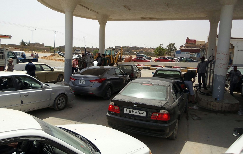 Fuel shortages back in 2014 sent Libyans in the al-Khums district, 110km east of Tripoli, queuing (AFP)