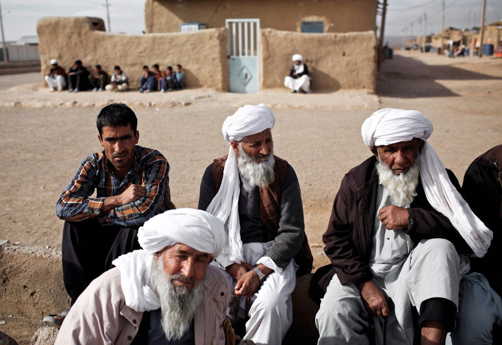 Afghan men at refugee camp in Taraz Nahid village near the city of Saveh, some 130km from Tehran (AFP)