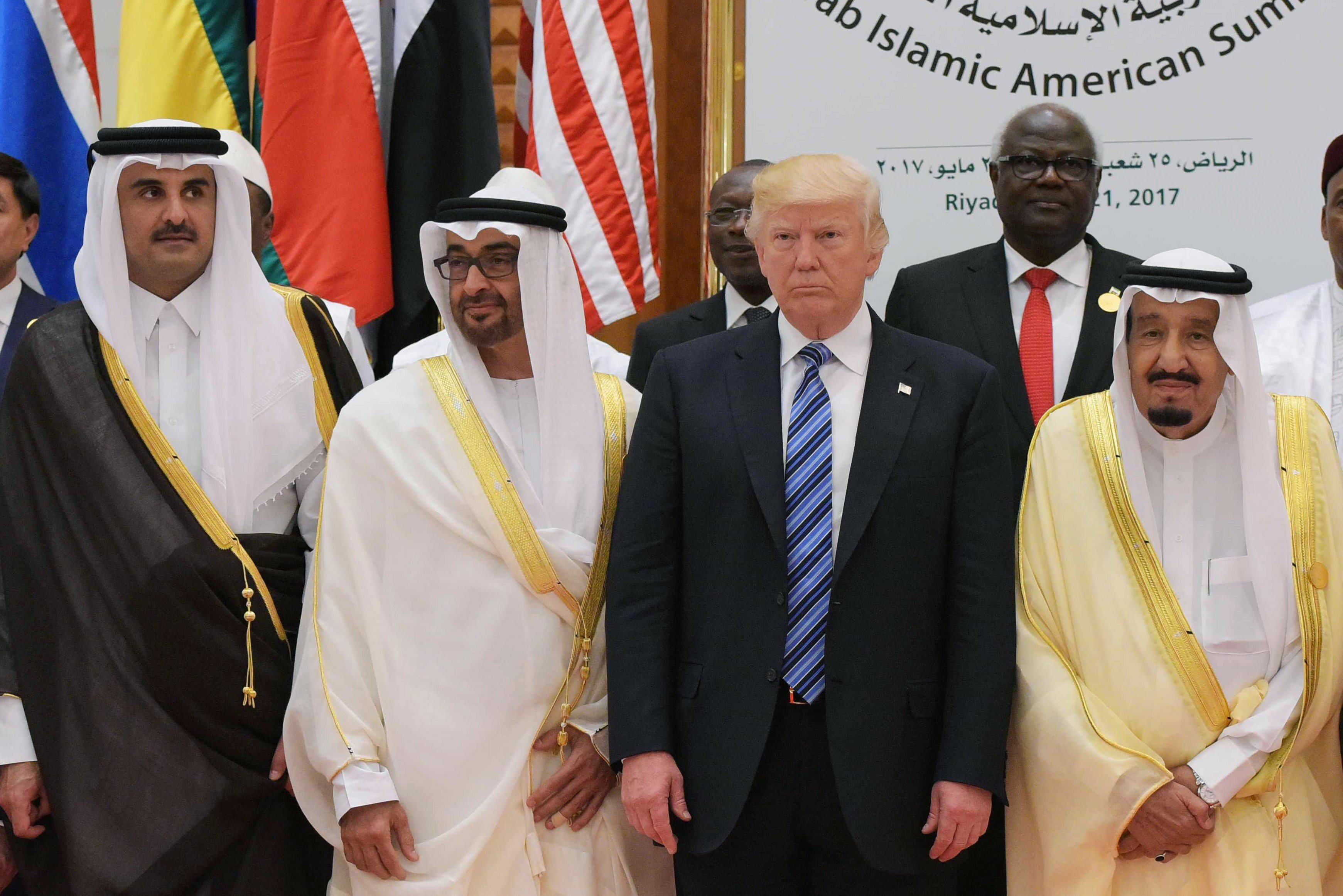 US President Donald Trump, Saudi Arabia's King, Crown Prince of Abu Dhabi and Qatr Emir pose for a group photo during the Arab Islamic American Summit at on 21 May, 2017 (AFP)