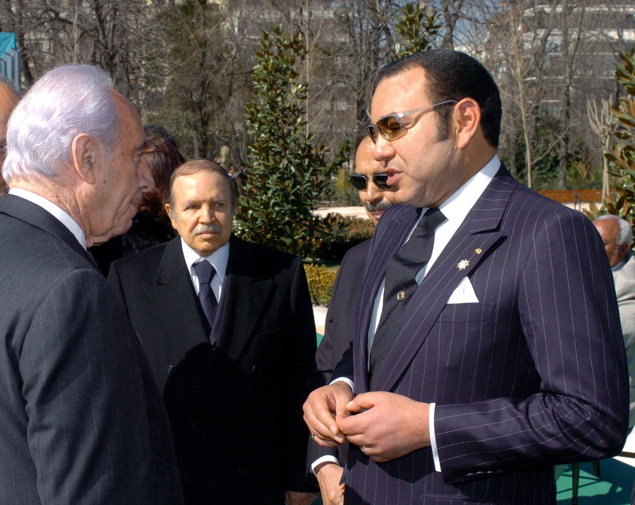 King of Morocco Mohamed VI (L) chats with Israeli Deputy Prime Minister Shimon Peres (R) as President of Algeria Abdelaziz Bouteflika (C) looks on, 11 March 2005