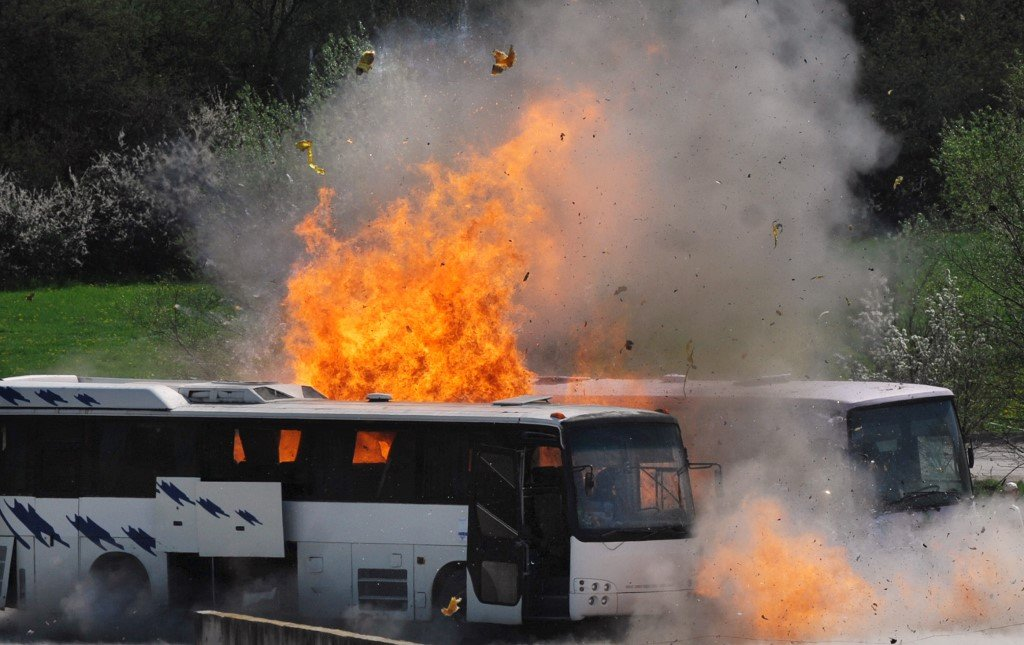 Buses explode as Albanian investigators reenact 2012 July bombing in Burgas to try to piece together what happened (AFP)