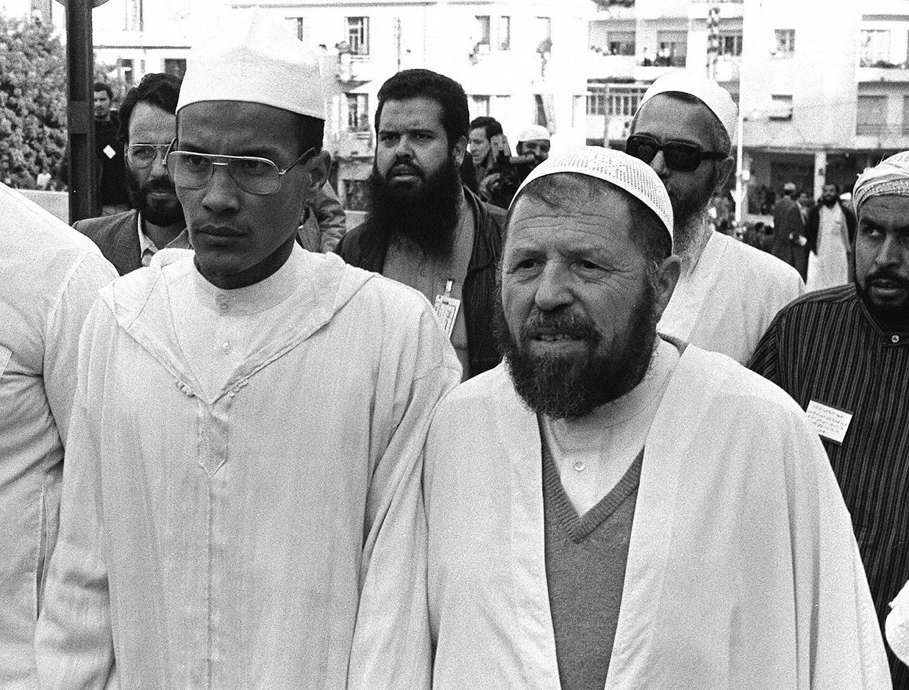 The historic leader of the Islamic Salvation Front (FIS), Abbasi Madani (R), stands next to Ali Belhadj, the movement's number two, in Algiers in May 1991 (AFP)