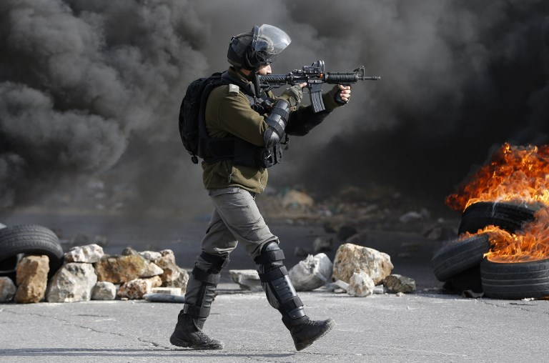 An Israeli border guard is pictured during clashes in the occupied West Bank on 12 January 2018 (AFP)