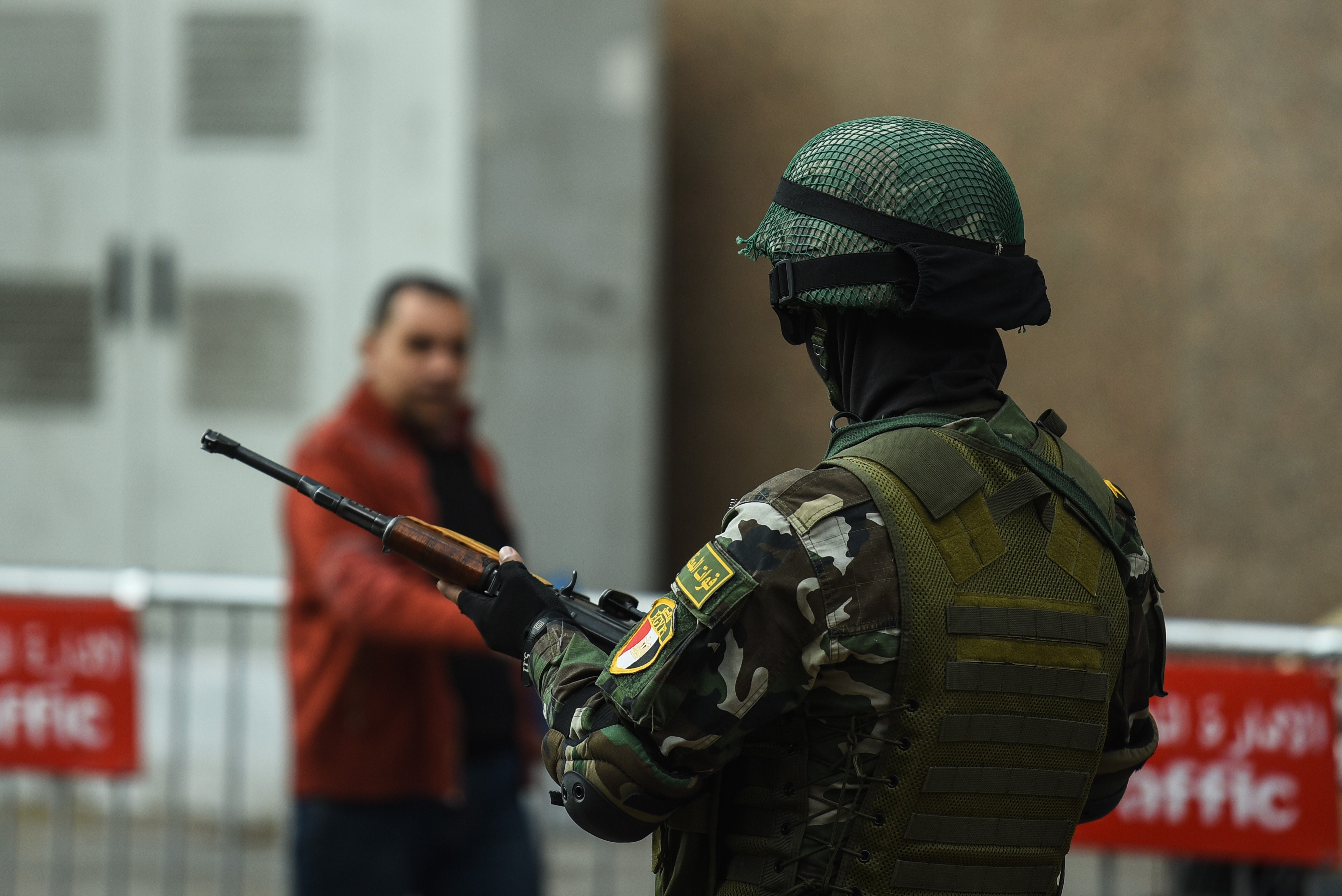 A member of the Egyptian special forces stands guard in front of the National Election Authority in Cairo (AFP)