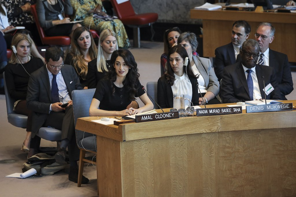 Human rights lawyer Amal Clooney (L) speaks as Iraqi human rights activist Nadia Murad Basee Taha and Nobel Peace Prize winner Denis Mukwege look on during a United Nations Security Council meeting at UN headquarters (AFP)