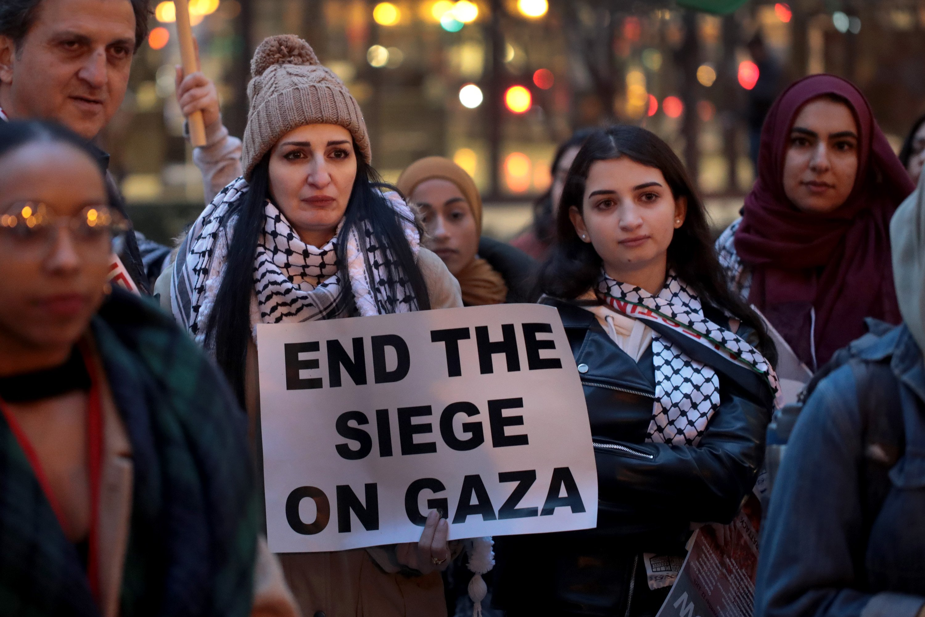 Demonstrators in the Federal Building Plaza protest the deaths of more than 30 Palestinians killed by Israeli air strikes in Gaza on 20 November (AFP)