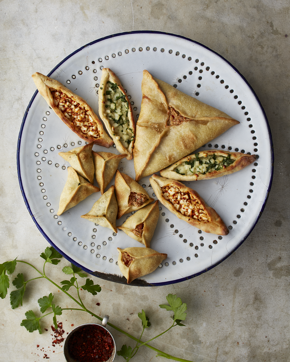 Lebanese fatayer with spinach and labneh fillings