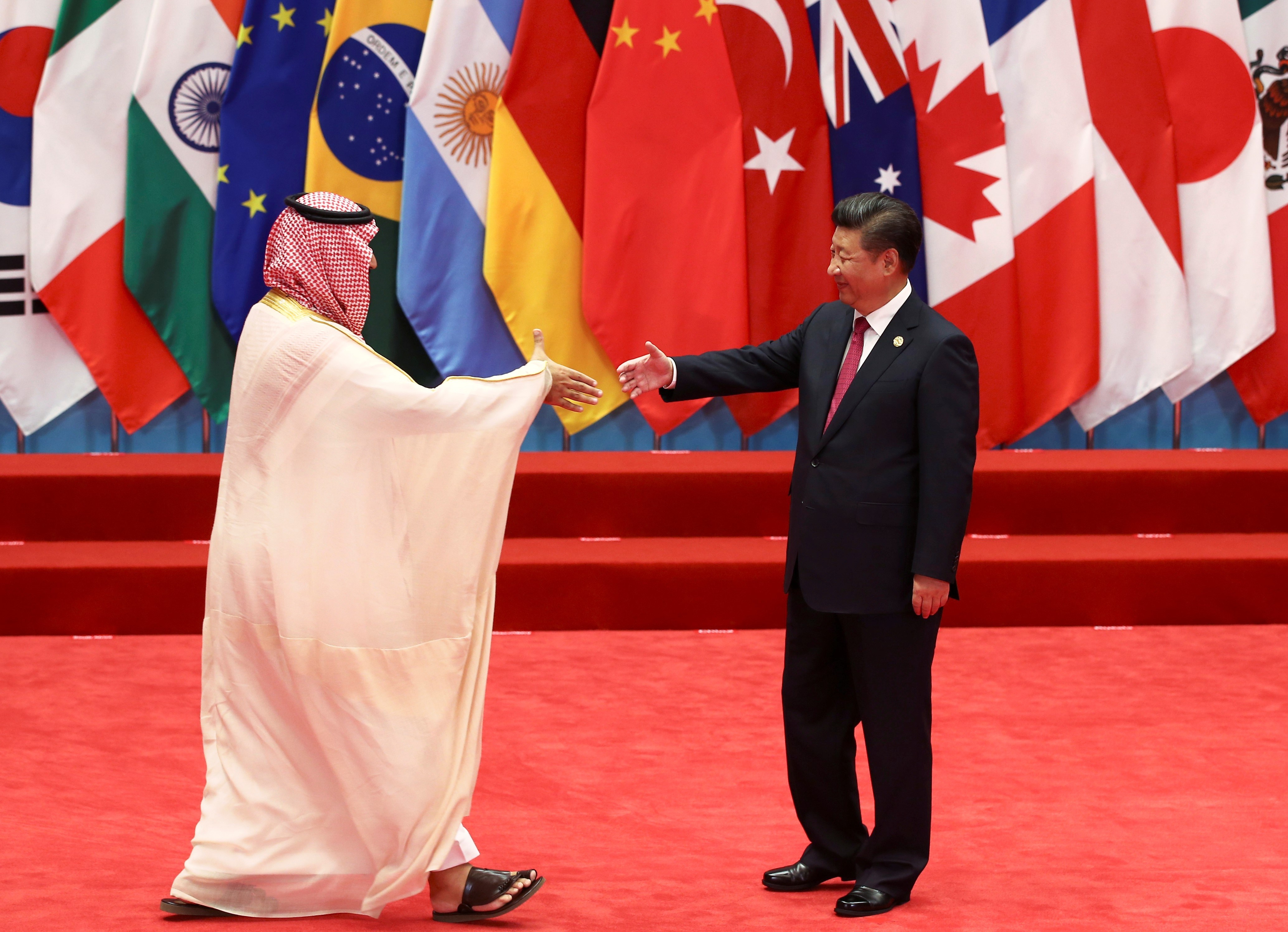 China's President Xi Jinping shakes hands with Crown Prince Mohammed bin Salman during the G20 Summit in Hangzhou, Zhejiang province, China (AFP)