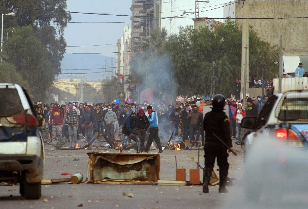 In Kasserine, Tunisian protesters clash with security forces over youth unemployment in 2016 (AFP)