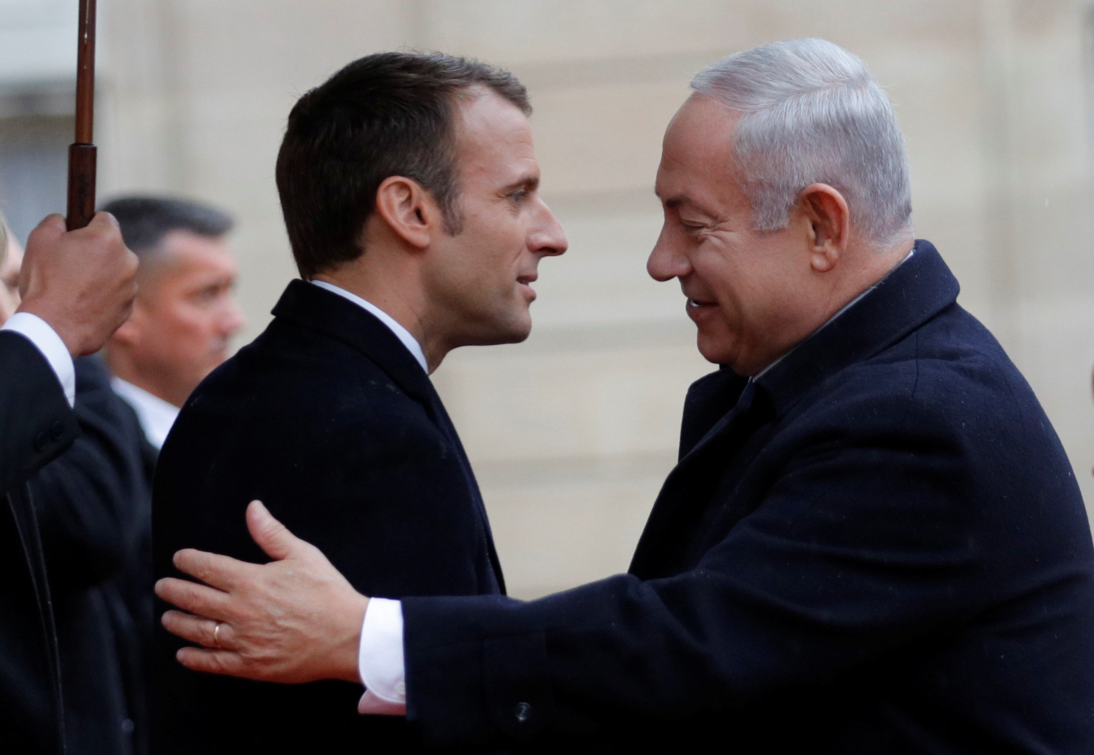 French President Emmanuel Macron welcome Israel Prime Minister Benjamin Netanyahu in Paris, France, on 11 November, 2018 (Reuters)
