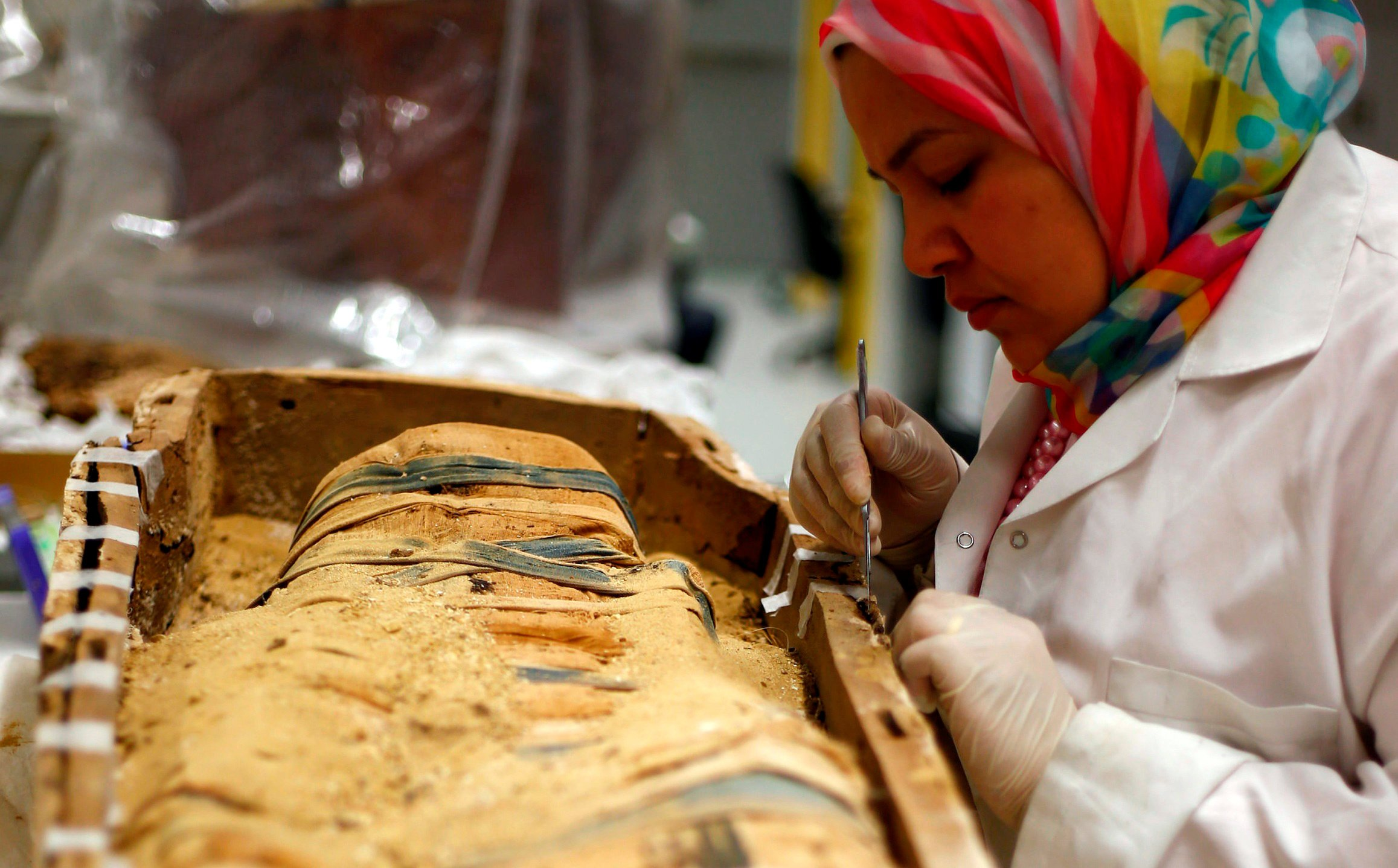 An Egyptian archaeological technician at the conservation centre renovates one of the mummies which was discovered near to Tutankhamun. Two stillborn children, believed to be his heirs, were also buried with him (Reuters)