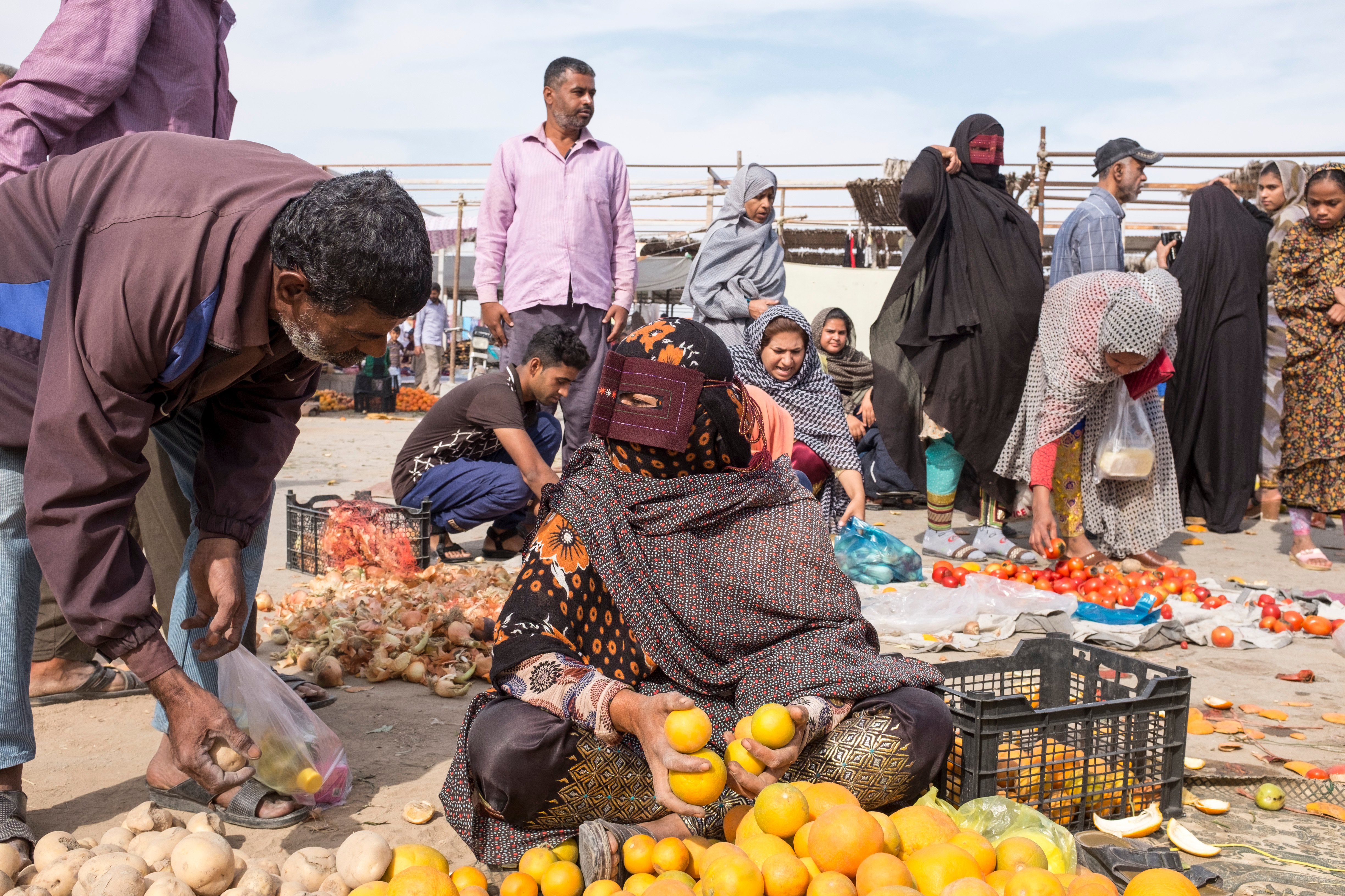 The women come from across Hormozgan Province to both buy and sell anything and everything, from embroidered trousers and fabrics to essentials such as vegetables and fruit (MEE)