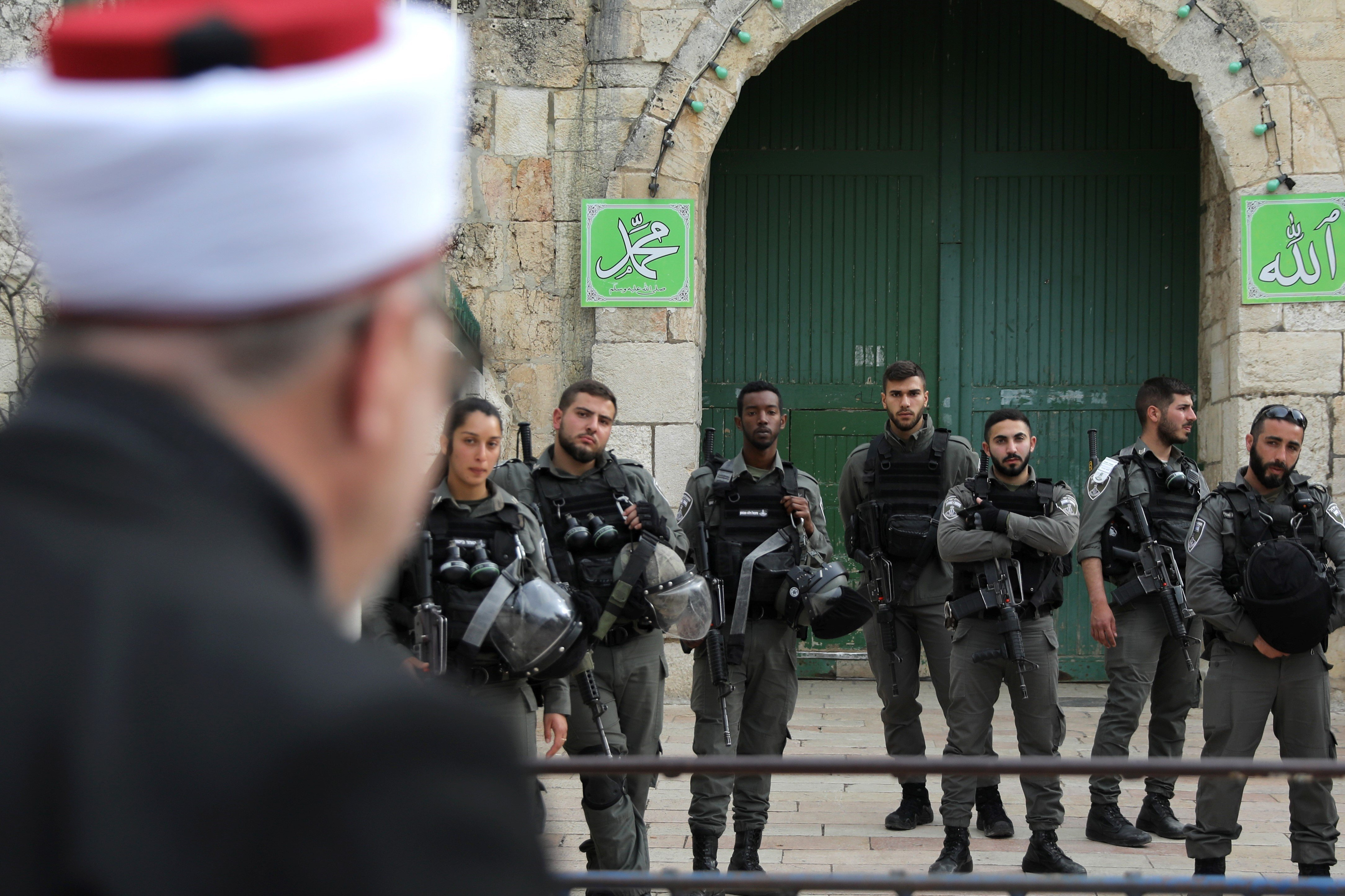 Israeli border police stand guard near the entrance door leading to the compound housing al-Aqsa Mosque in Jerusalem's Old City March 12, 2019. REUTERS