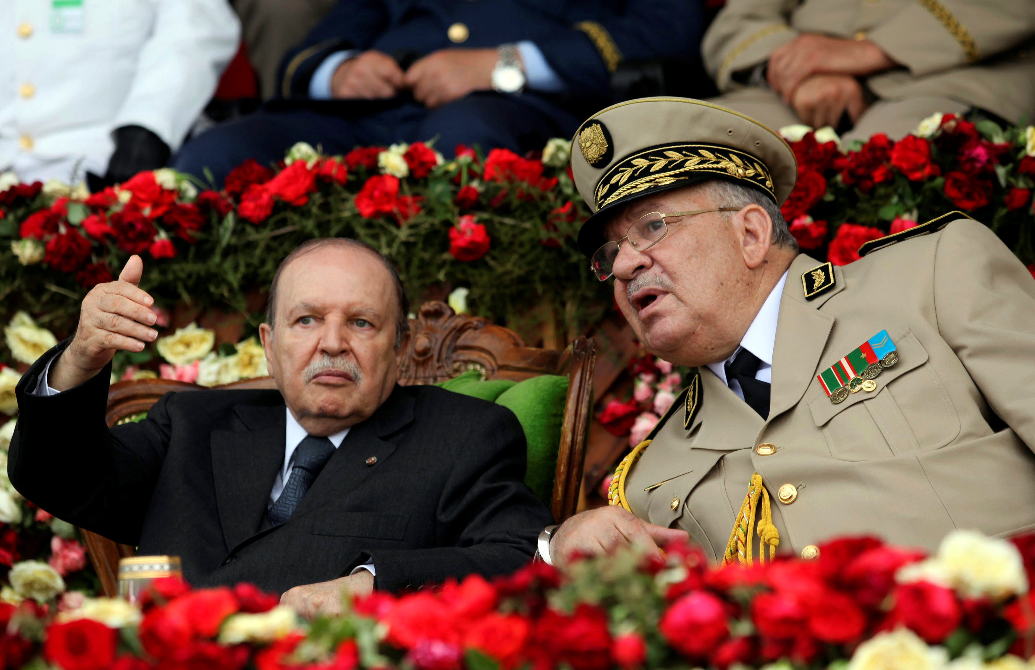 Army Chief of Staff Ahmed Gaid Salah, right, said that Algerian President Abdelaziz Bouteflika, left, is 'unfit to rule' (Reuters)