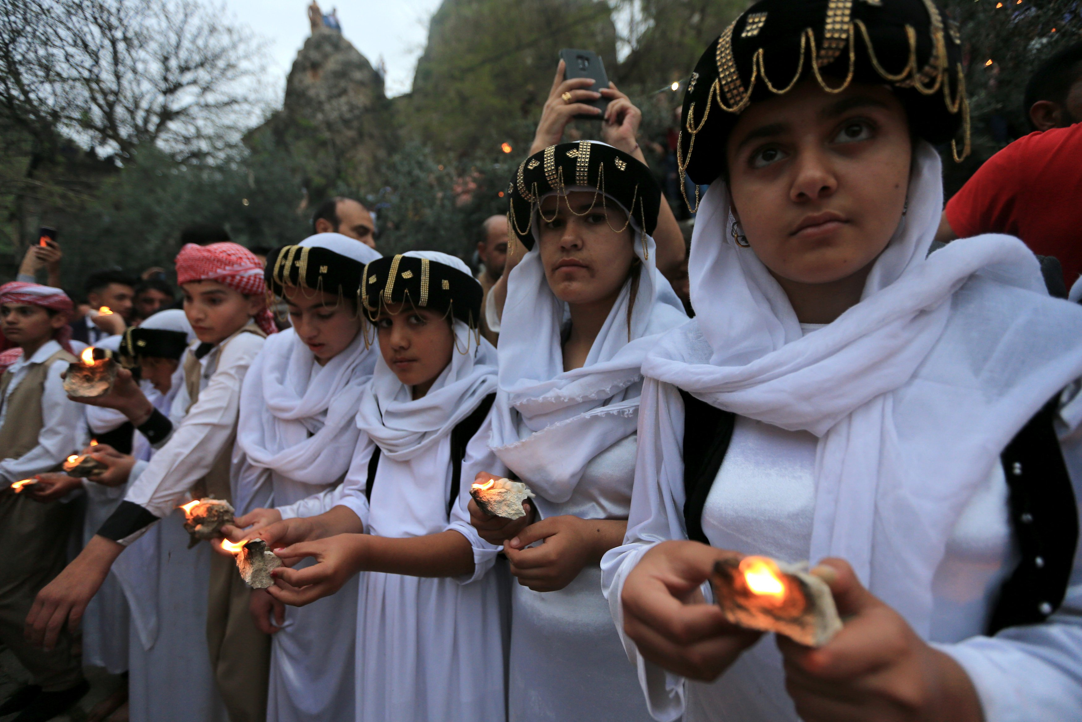 In pictures: Yazidis celebrate New Year at ancient temple