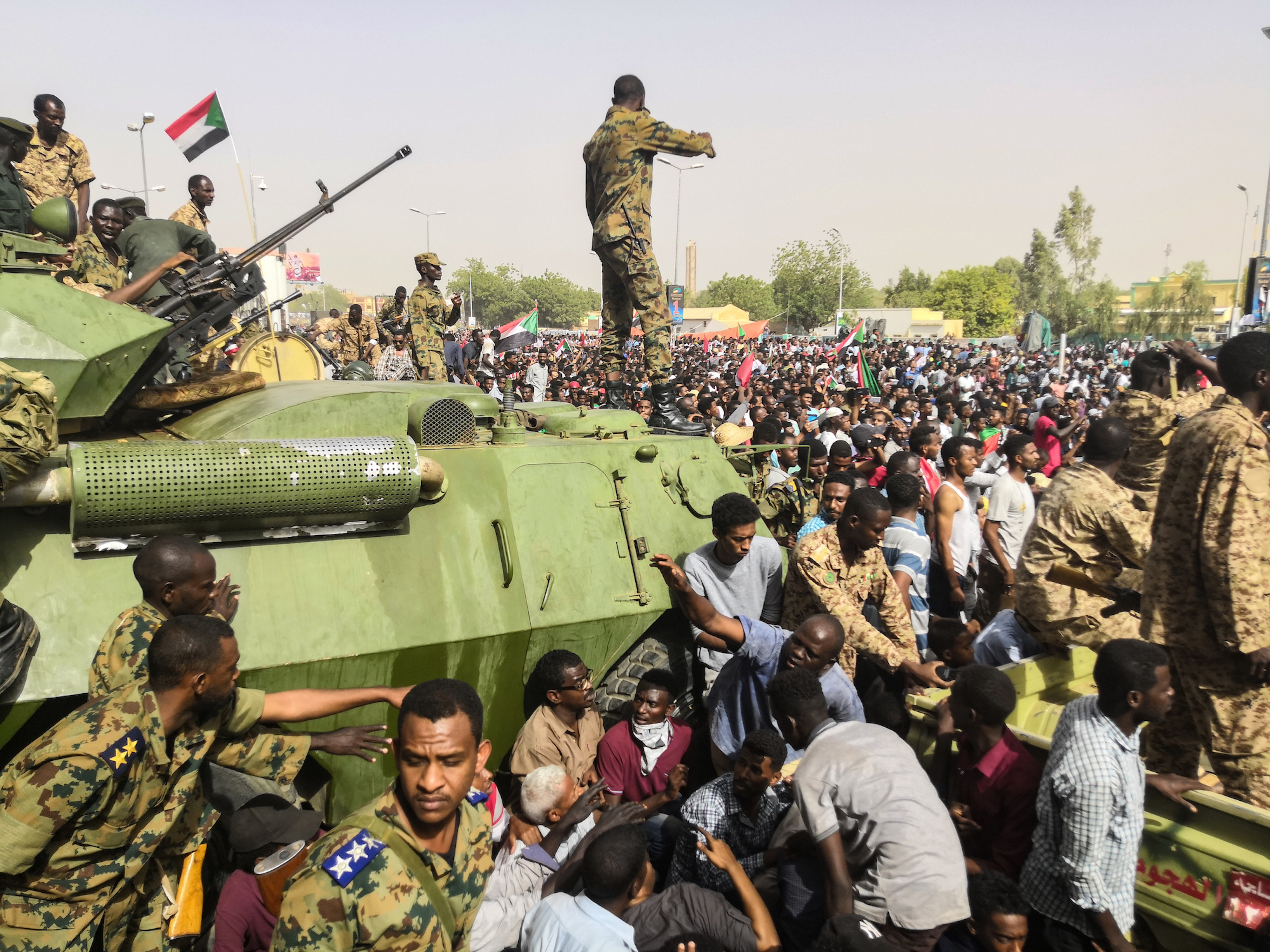 live sudanese protesters wait on army to confirm bashir