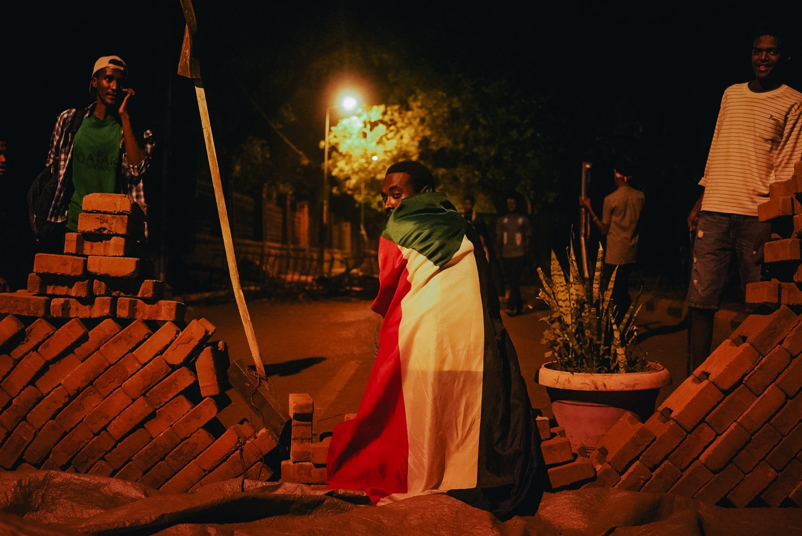Sudanese protesters have built barricades in the streets near Colombia (MEE/Kaamil Ahmed)