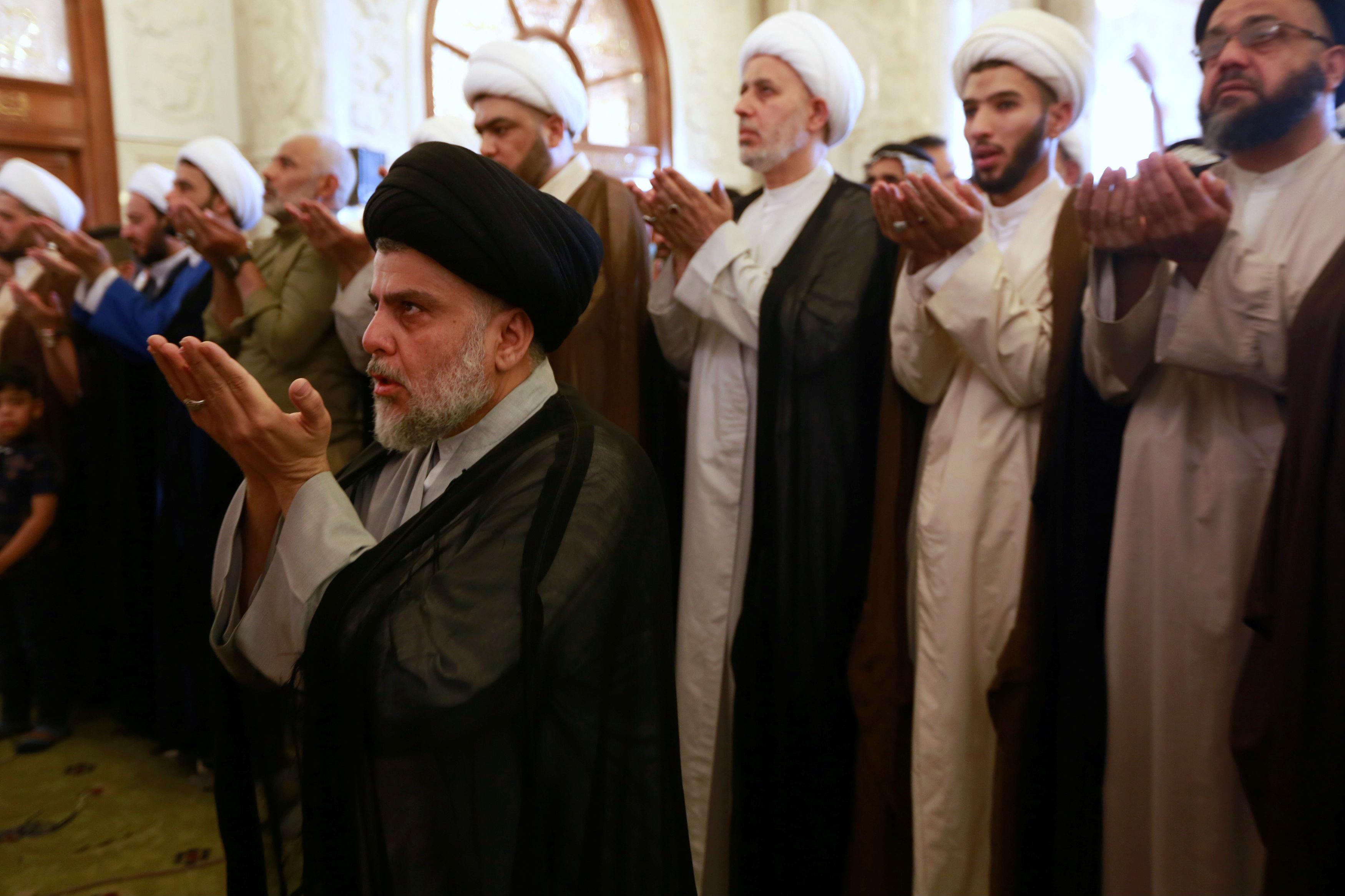 Muqtada al-Sadr performs Eid al-Fitr prayers marking the end of the fasting month of Ramadan at the Kufa Mosque near Najaf, Iraq (Reuters)