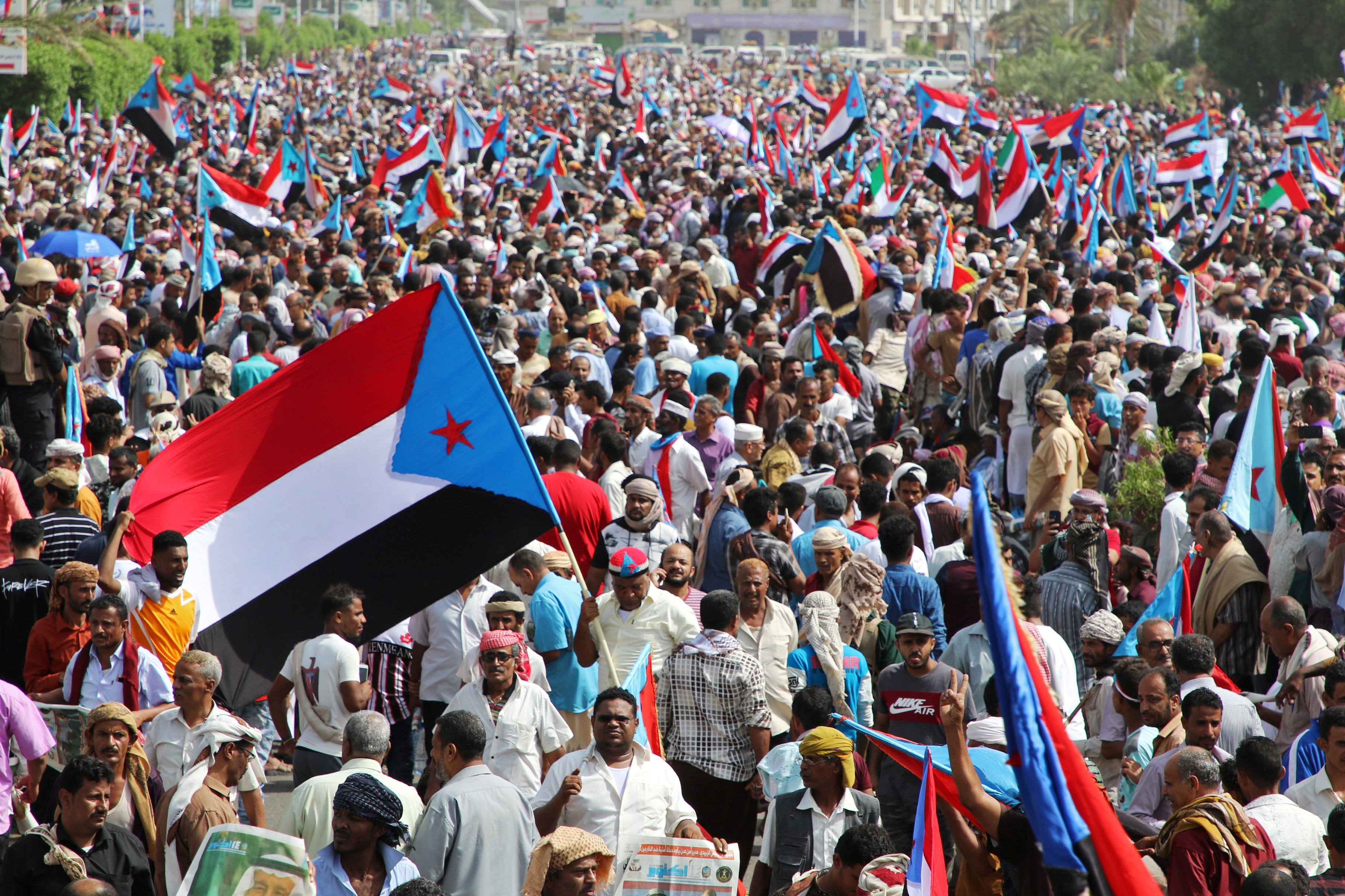 Supporters of Yemen's UAE-backed southern separatists march during a rally in southern port city in Aden (Reuters)