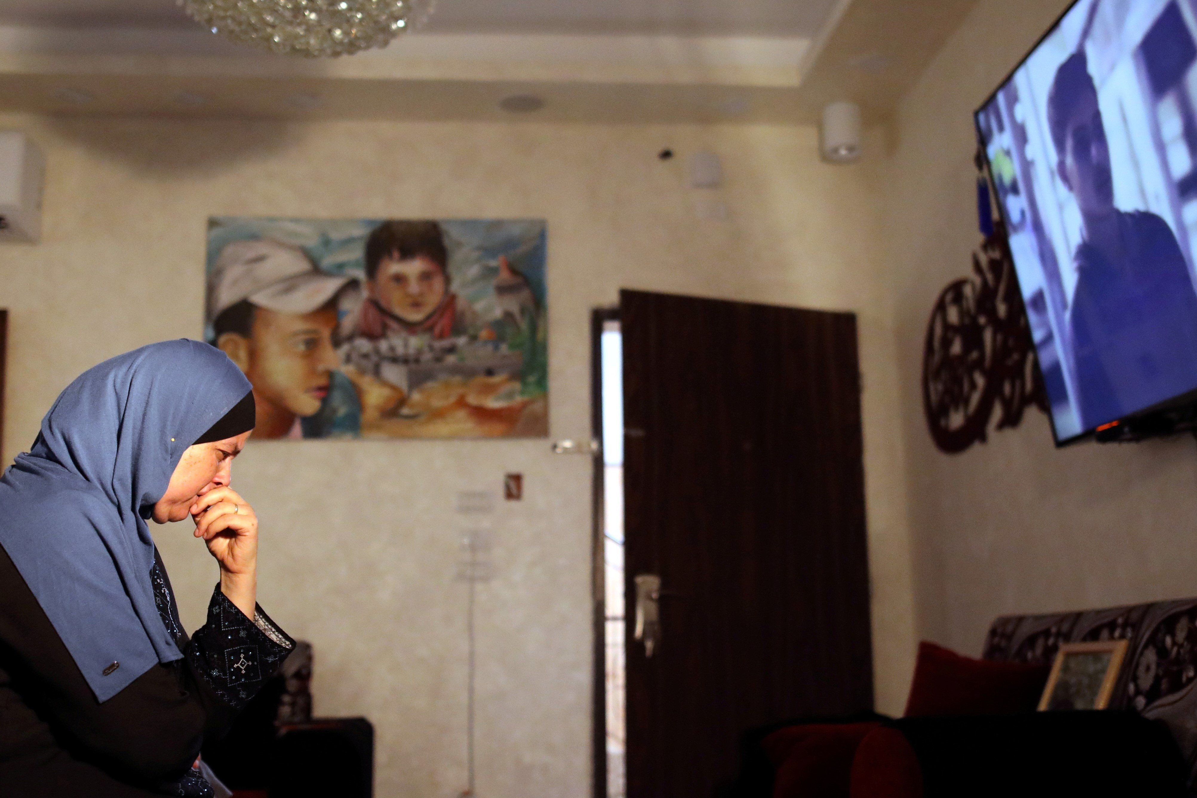 "Suha Abu Khdeir, whose son's murder is the subject of the HBO series ""Our Boys"", watch the show's first two episodes in their East Jerusalem home on 18 August (Reuters)"