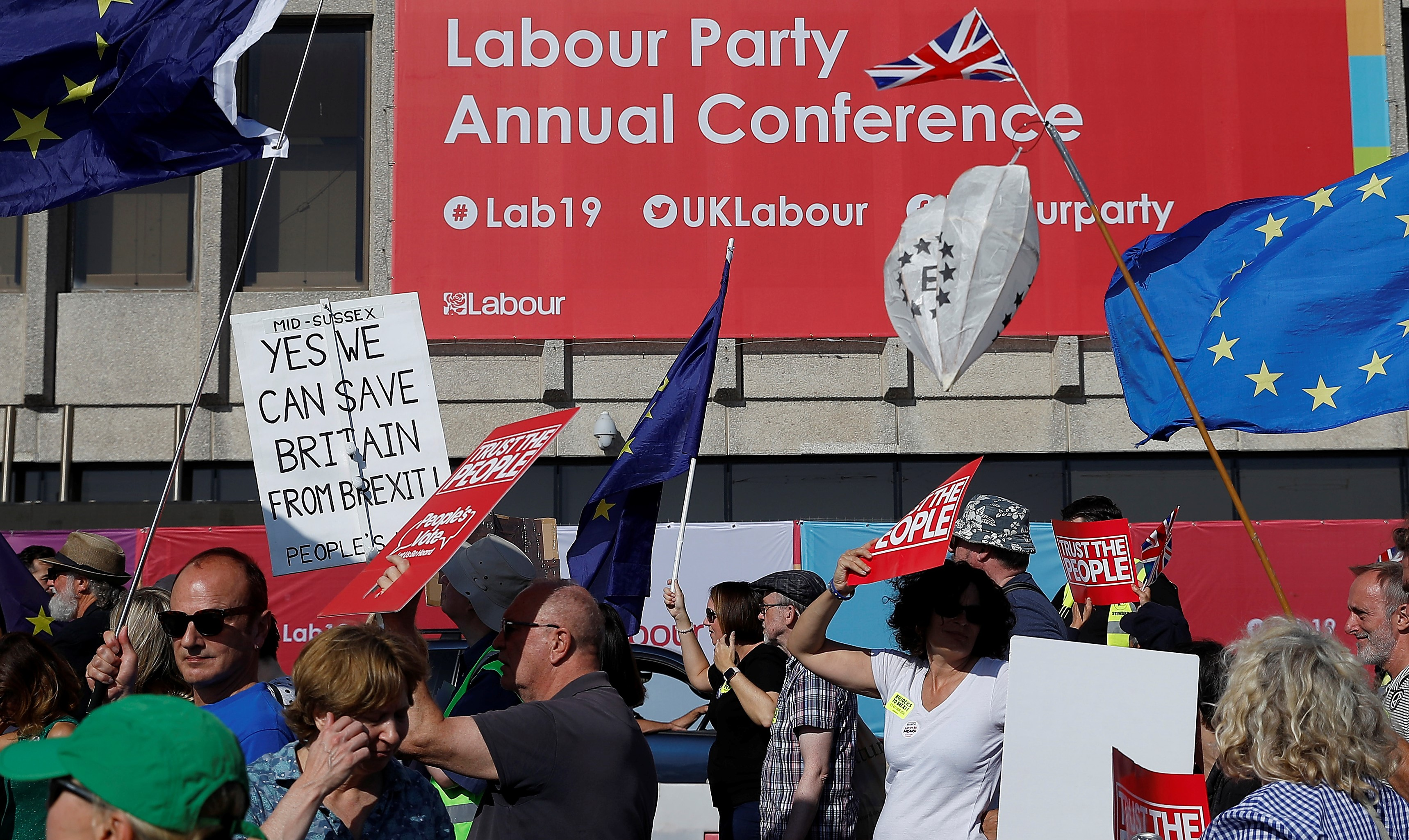 Participants in a People's Vote demonstration walk past the Brighton Centre where the Labour Party Annual Conference is being held, in Brighton, Britain, September 21, 2019.