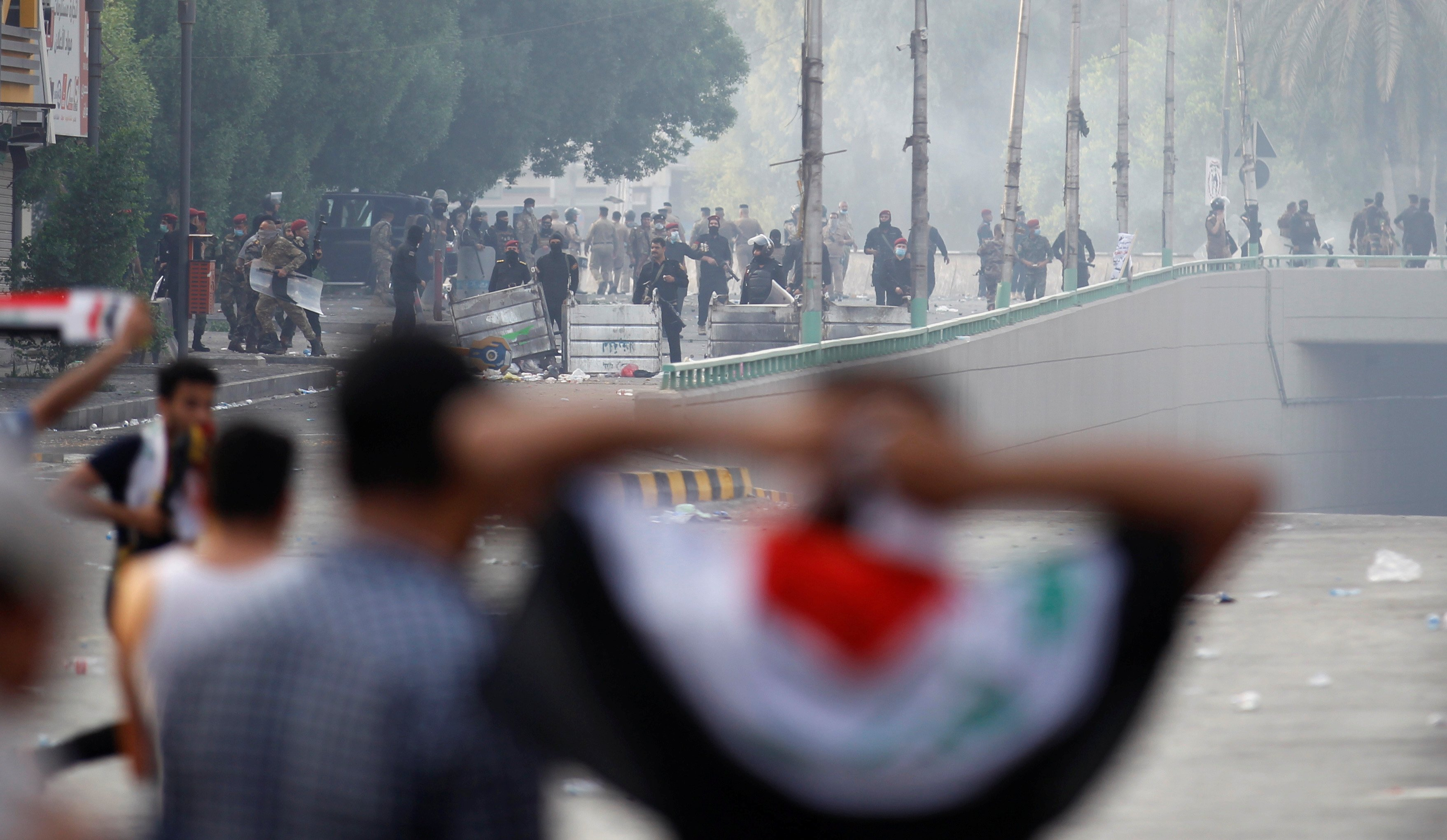 Demonstrators disperse as Iraqi Security forces use tear gas during a protest against government corruption amid dissatisfaction at lack of jobs and services at Tahrir square in Baghdad, Iraq October 1, 2019