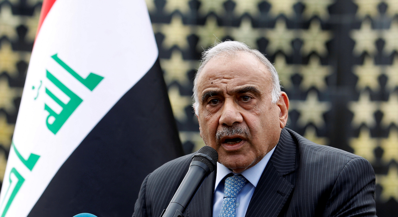Iraqi Prime Minister Adel Abdul Mahdi speaks during a symbolic funeral ceremony (Reuters)