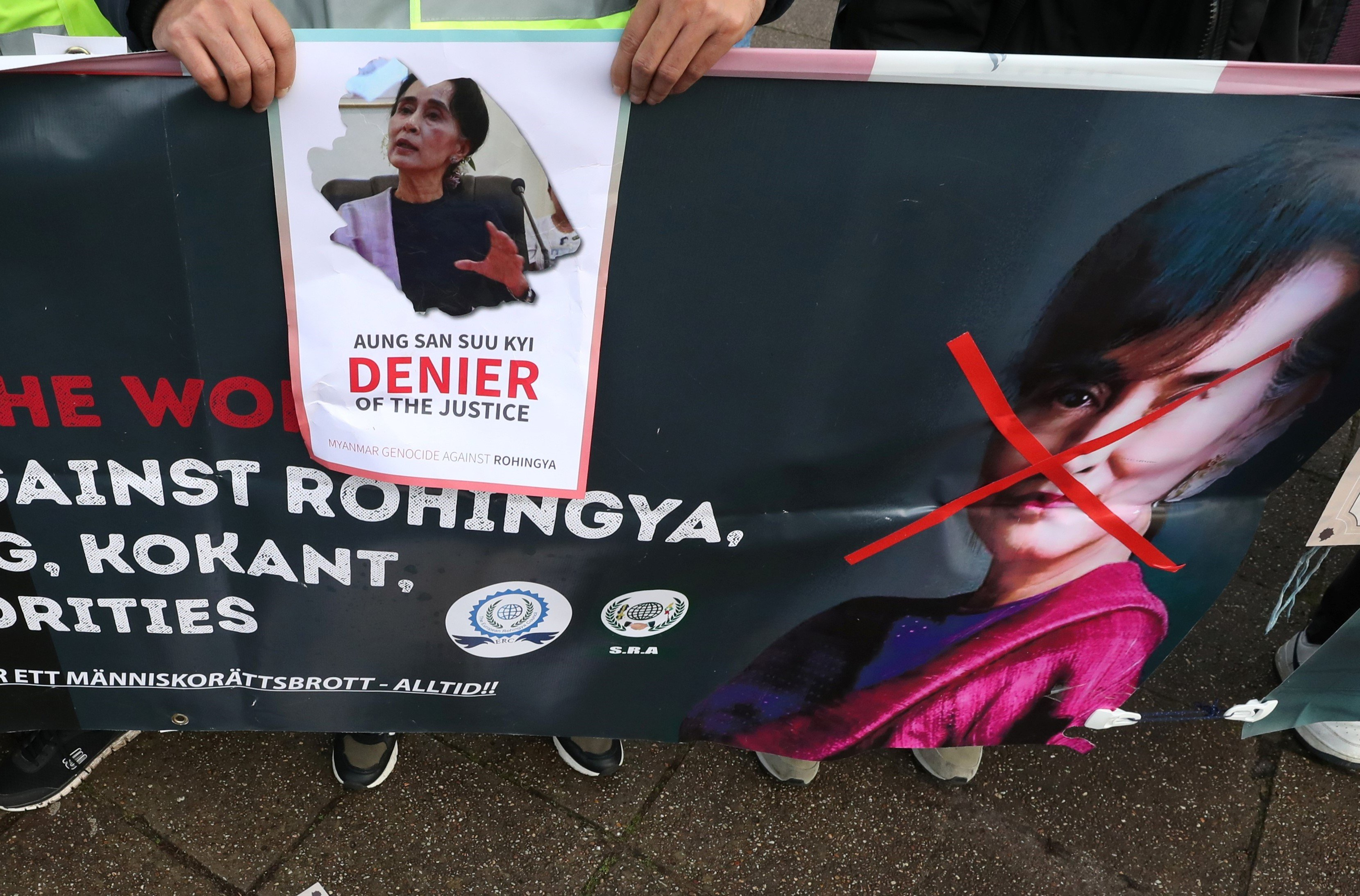 People protest against Myanmar's leader Aung San Suu Kyi on the second day of hearings in a case filed by Gambia against Myanmar alleging genocide against the minority Muslim Rohingya population, outside the International Court of Justice (ICJ) in The Hague, Netherlands December 11, 2019