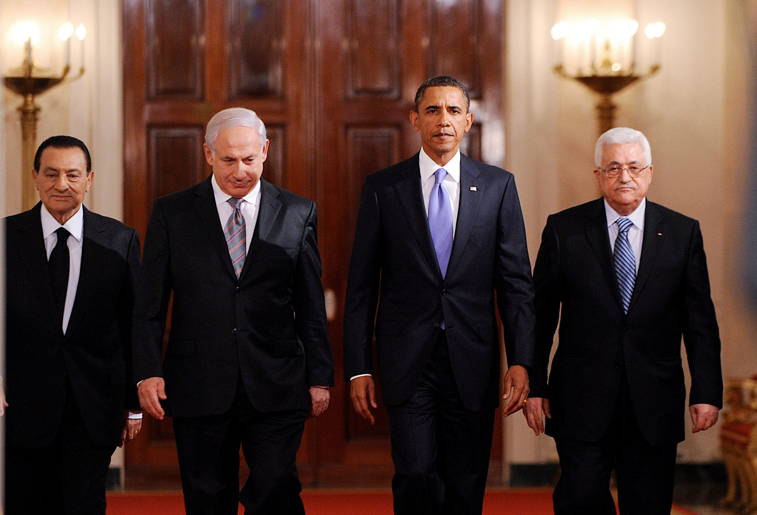US President Barack Obama walks with Middle East leaders in the East Room of the White House in Washington, DC, USA, on 1 September, 2010 (Reuters)
