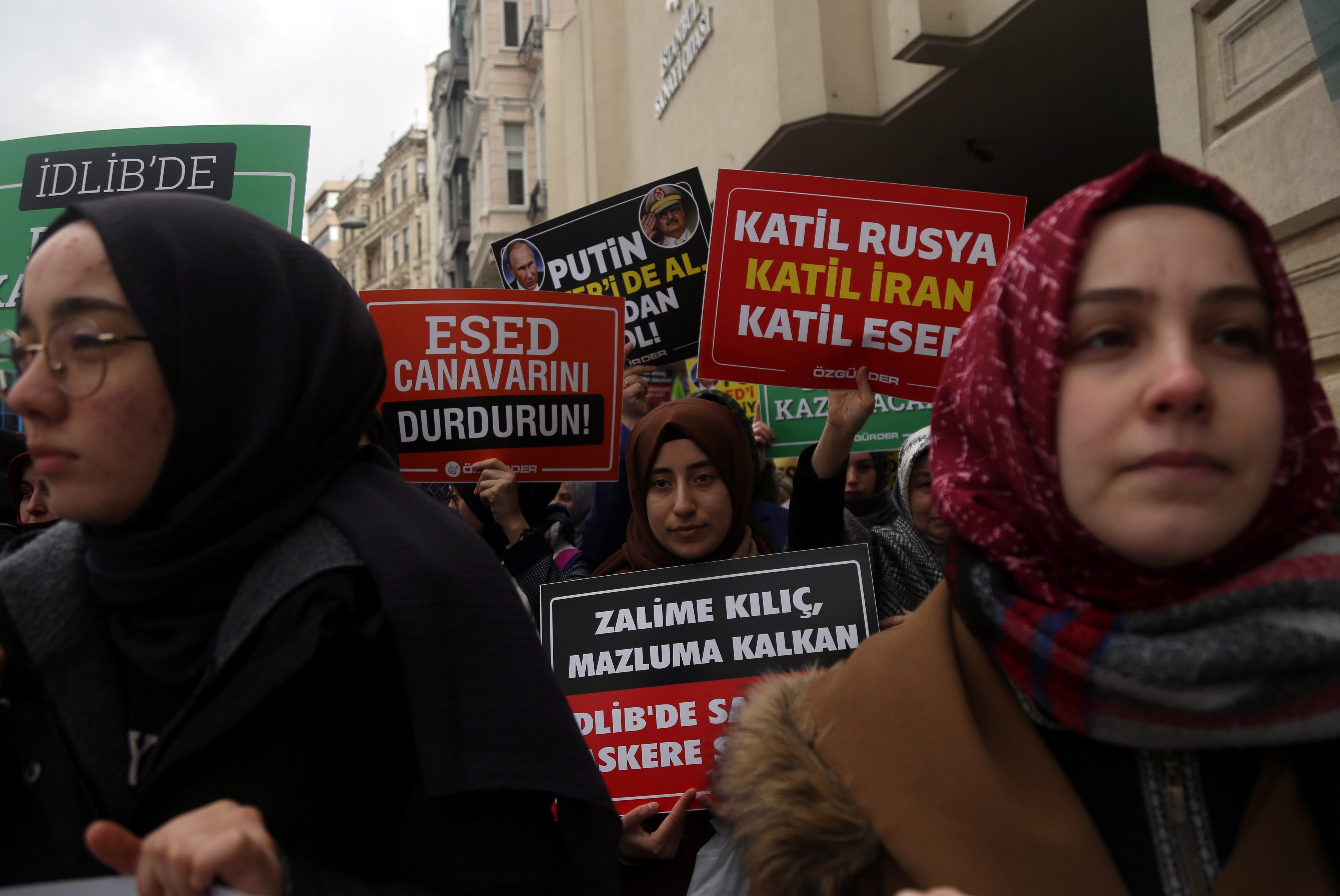 Demonstrators hold placards during a protest against killing of Turkish soldiers in Syria's Idlib region, near the Russian Consulate in Istanbul, Turkey, February 29, 2020