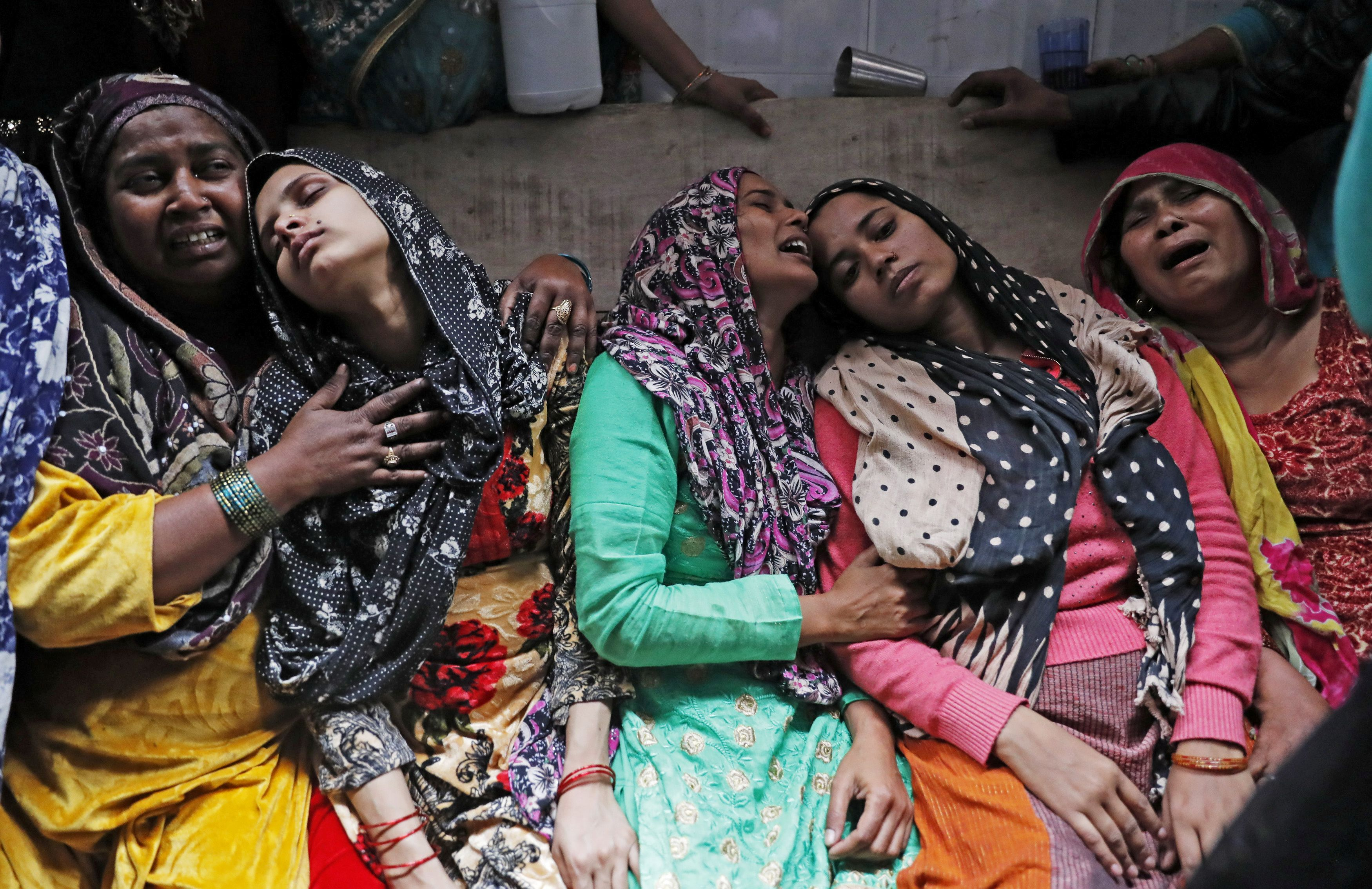 Relatives mourn next to the body of Hashim Ali who succumbed to his injuries, in a riot affected area in New Delhi, India, on 29 February