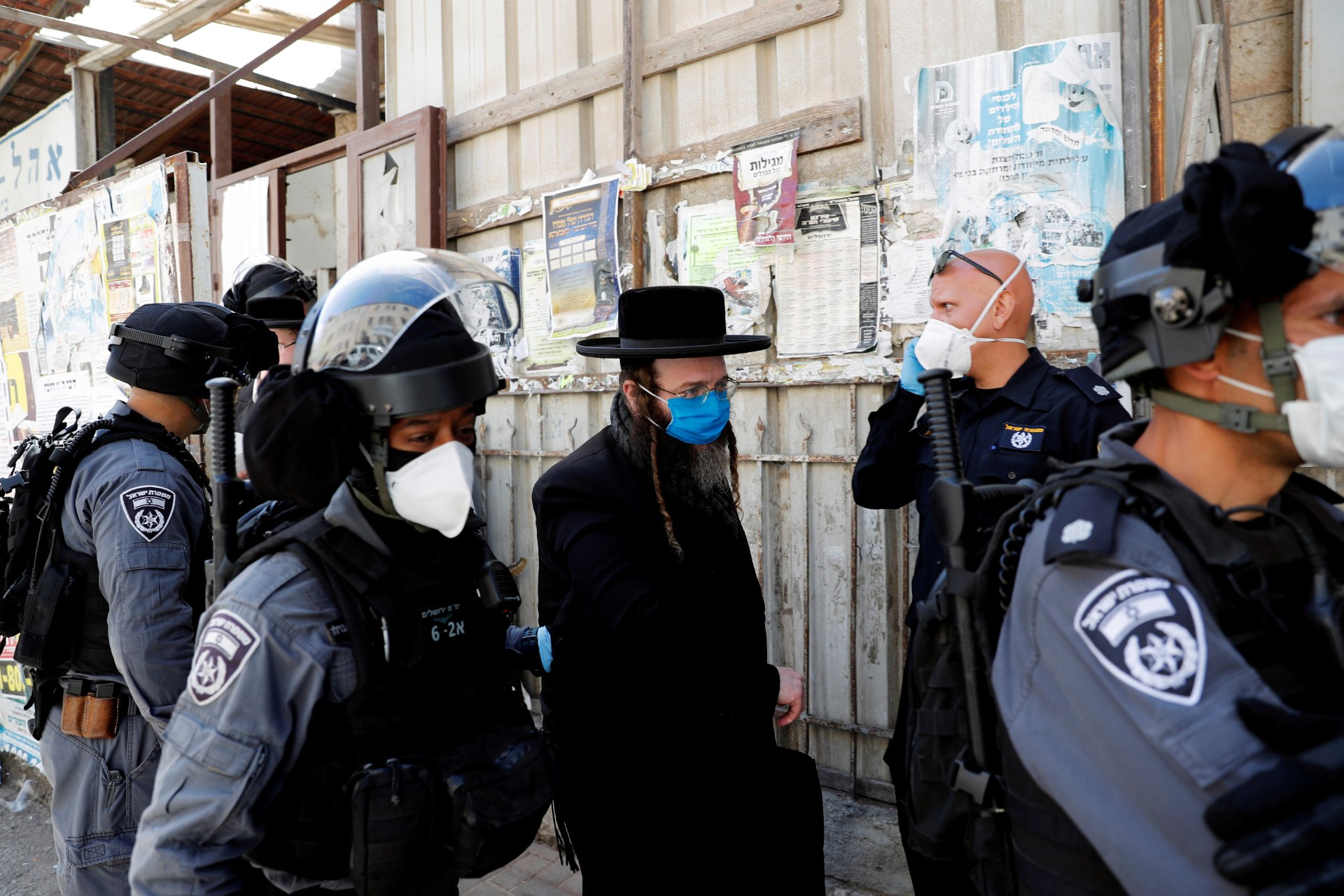 Israeli police detain an Ultra-Orthodox Jewish man for defying government restrictions set in place to curb the spread of the coronavirus disease, in th Mea Shearim neighborhood of Jerusalem (Reuters)