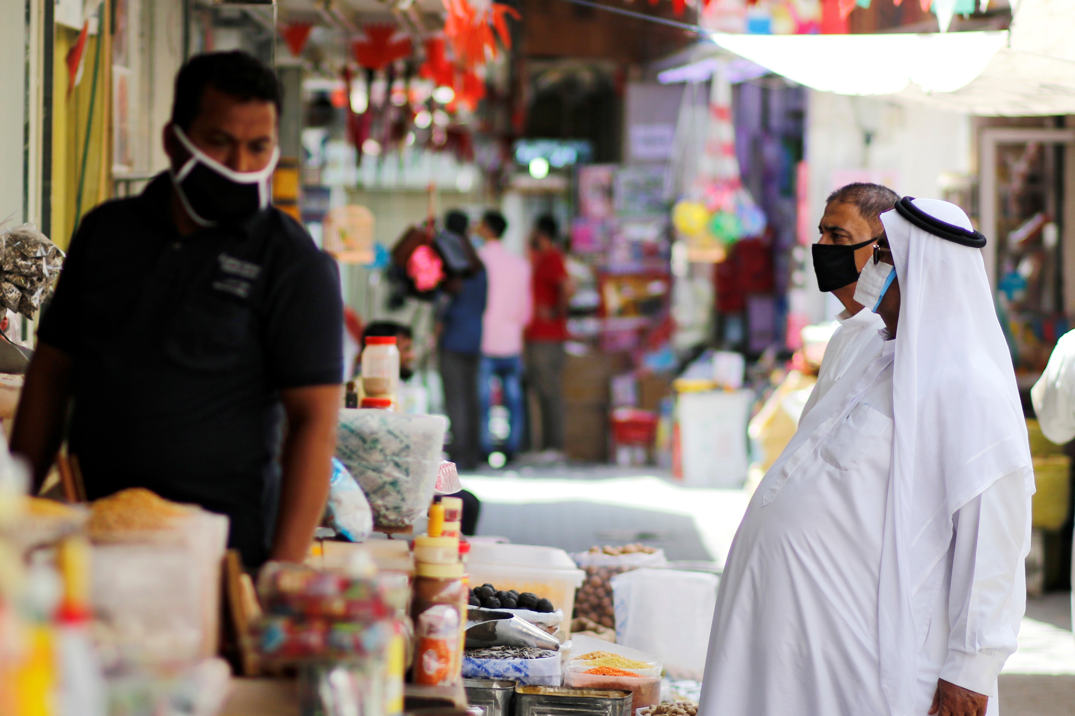 People wear protective face masks following the outbreak of the coronavirus disease (COVID-19), as they shop ahead of the holy month of Ramadan in Manama, Bahrain, April 23, 2020