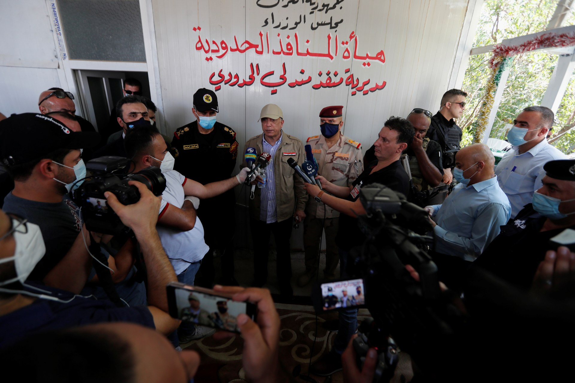 Iraqi Prime Minister Mustafa al-Kadhimi speaks to the media at Mandali border crossing between Iraq and Iran (Reuters)