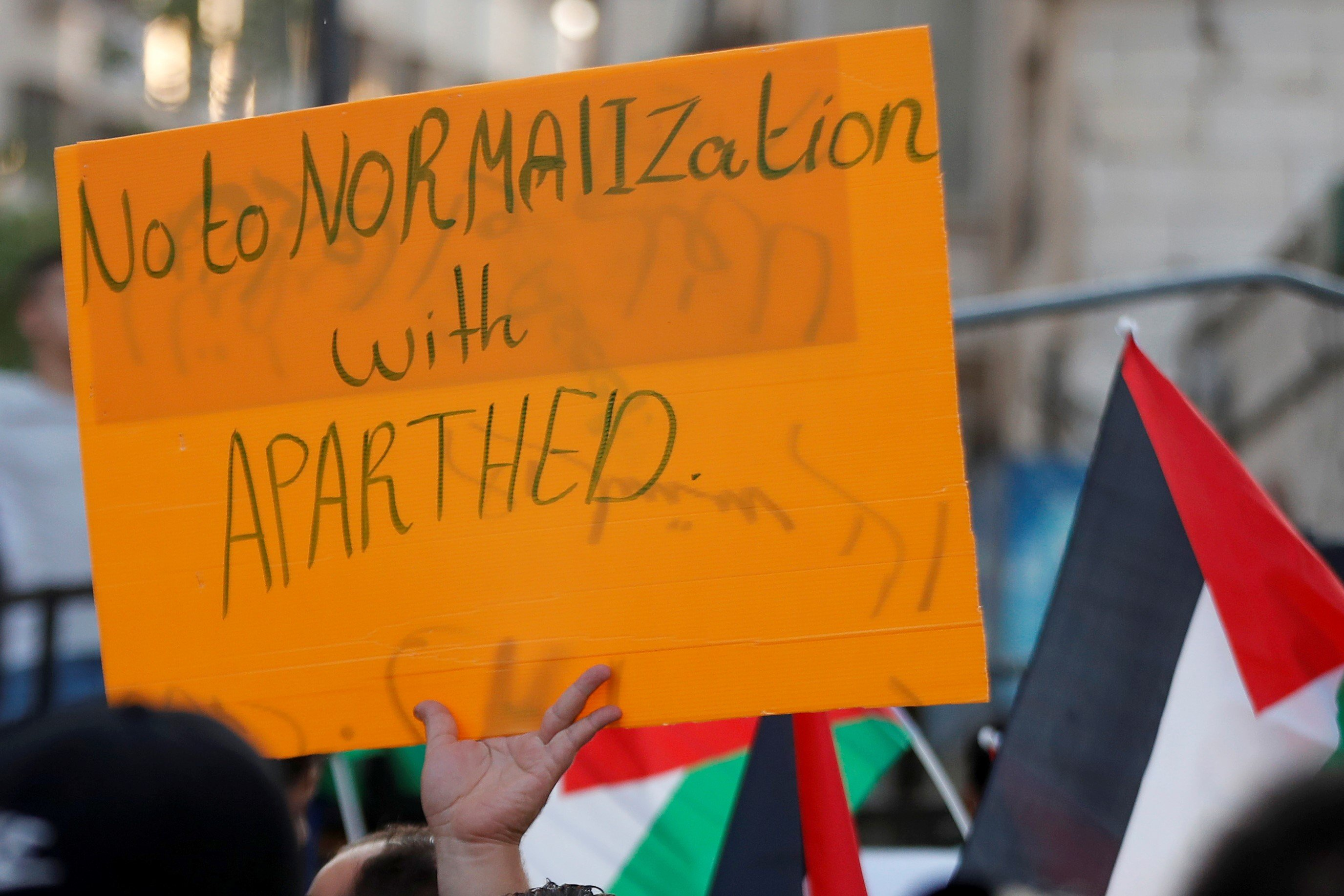 A Palestinian demonstrator holds a sign during a protest against the United Arab Emirates and Bahrain's deal with Israel to normalise relations, in Ramallah in the Israeli-occupied West Bank September 15, 2020
