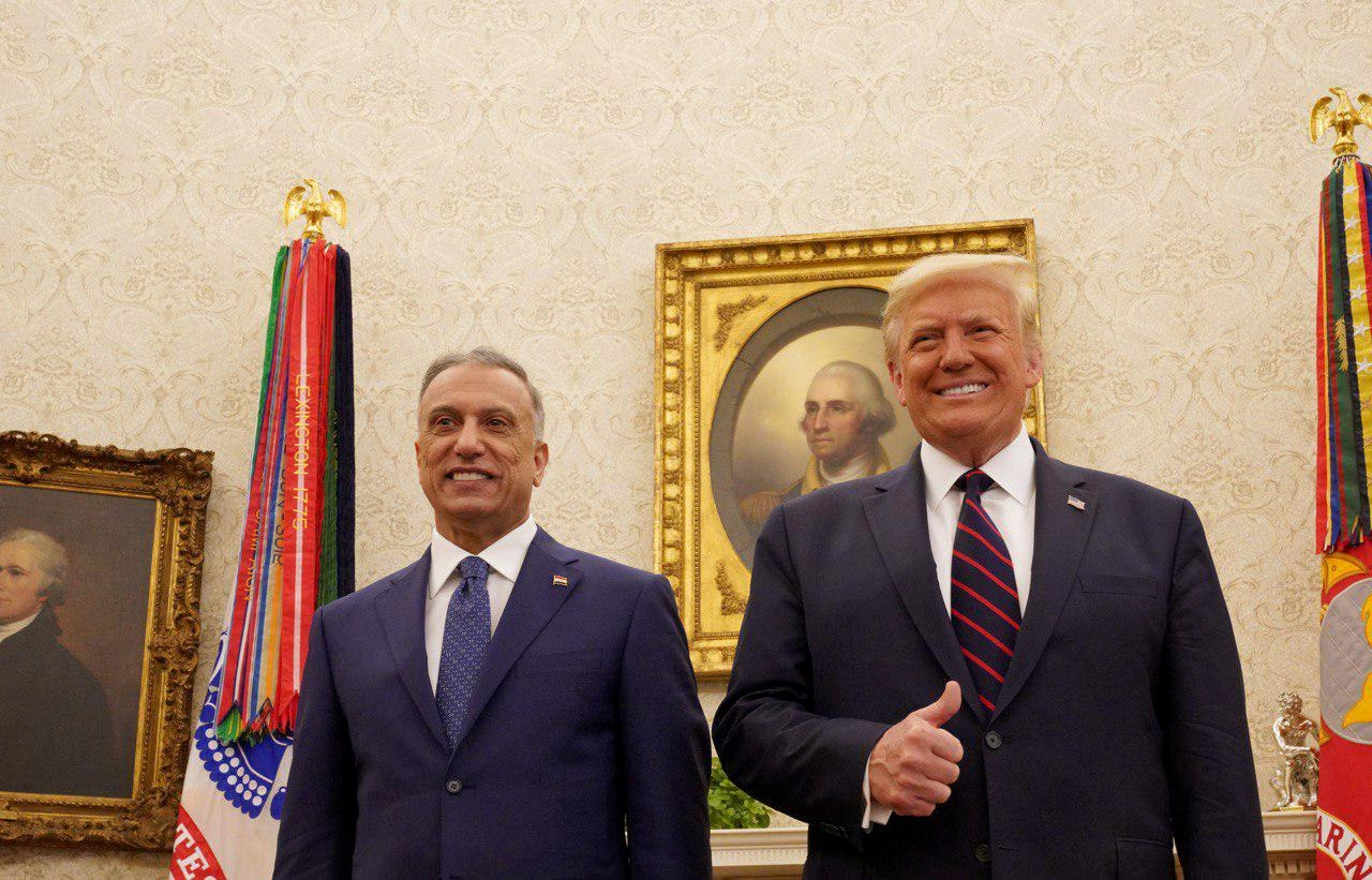 US President Donald Trump receives Iraq's Prime Minister Mustafa al-Kadhimi in the Oval Office at the White House in Washington in August (Reuters)