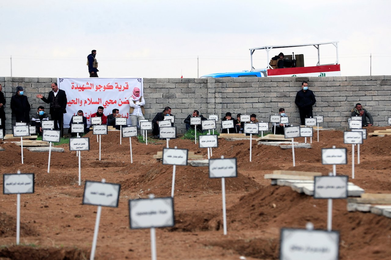Burial of victims killed by Islamic State after bodies' exhumation from mass graves, in Kojo (Reuters)