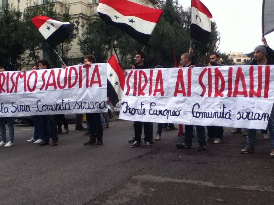 A demonstration in support of Assad by the ESFS in 2014, holding a banner saying