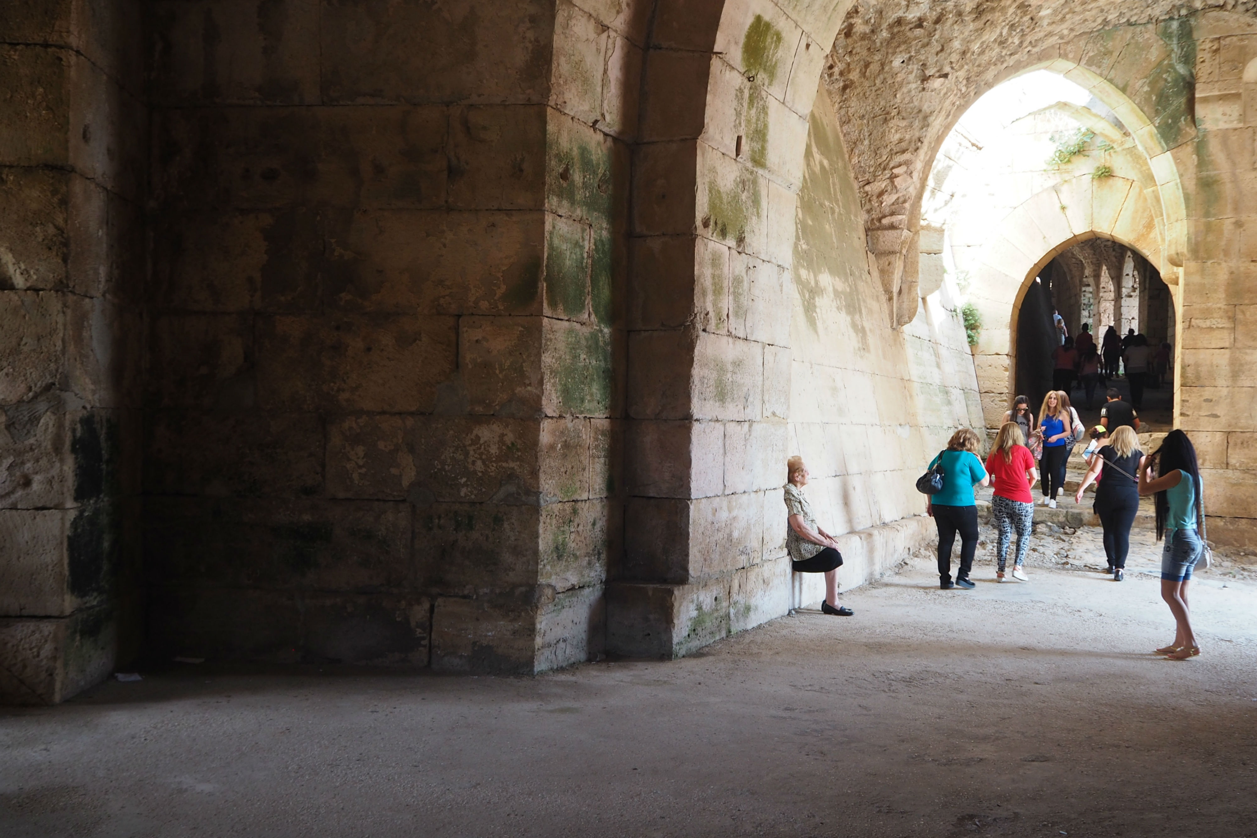 Syrian visitors are starting to return to the castle, although sections were damaged during the war (Tom Westcott/MEE)
