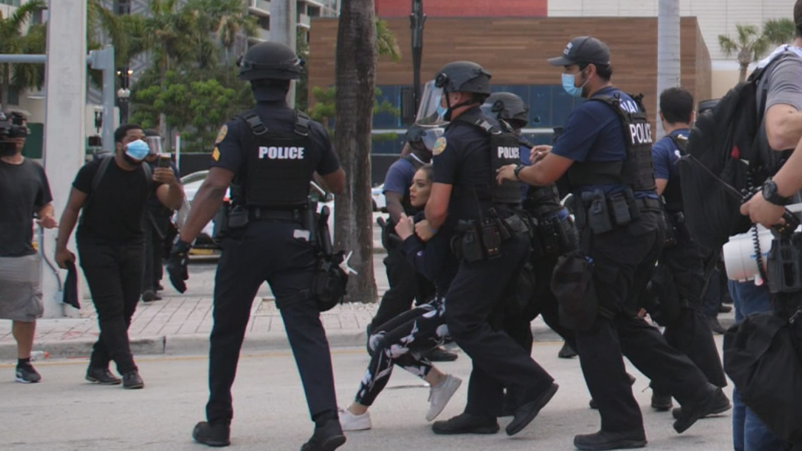 Alaa Massri, 18, being arrested during a protest in Miami on 10 June (CAIR-Florida)