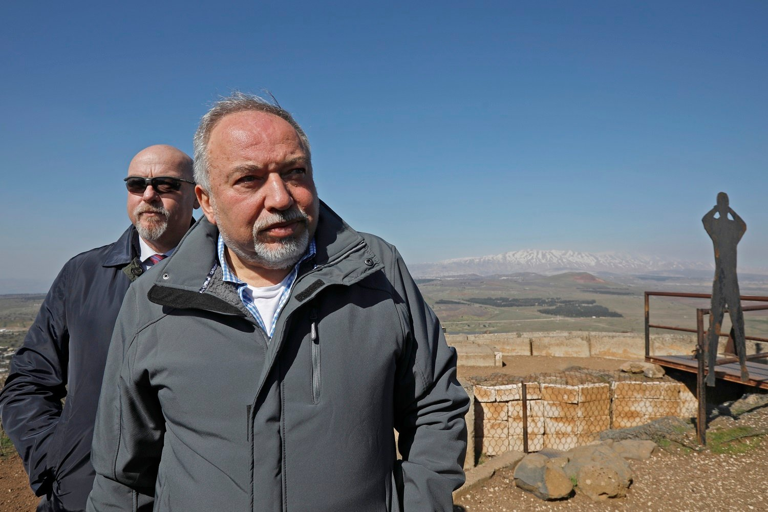 Avigdor Lieberman visits a lookout on  Mount Bental in the Golan Heights in February 2019 (AFP)