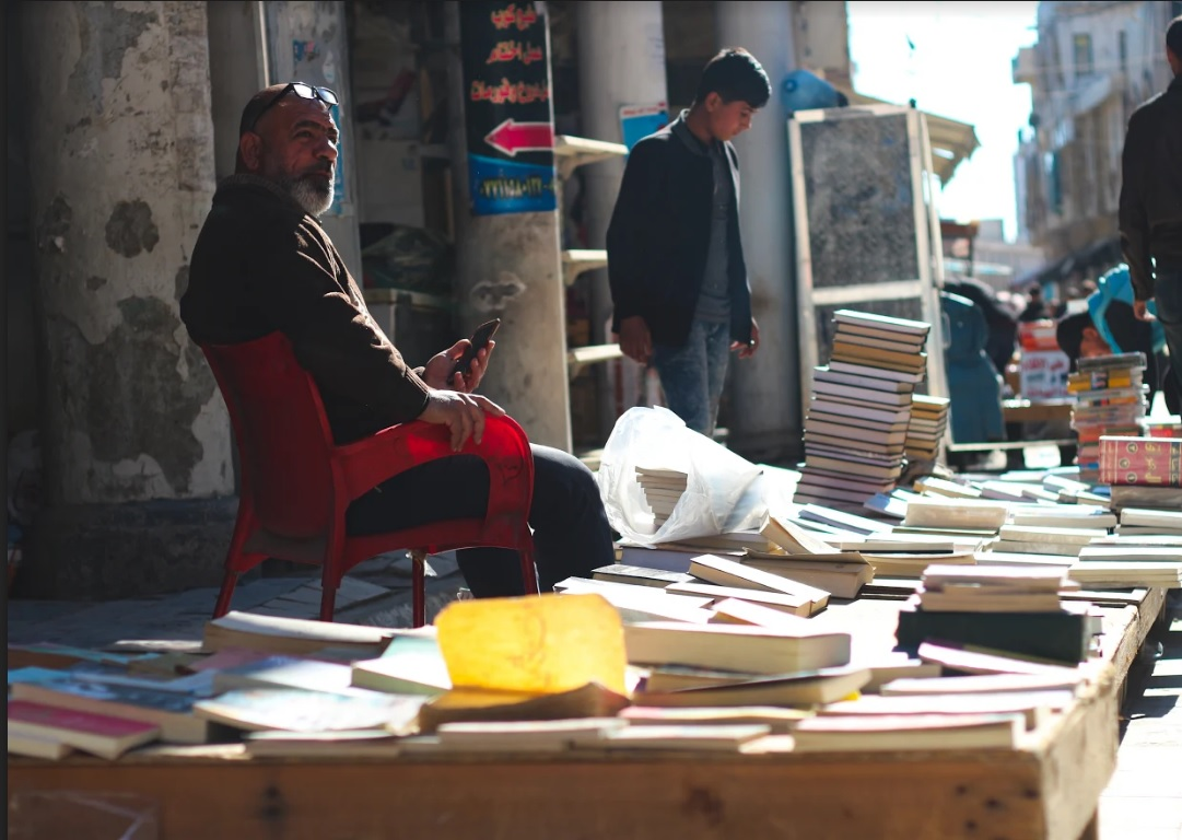 Books stacked high at the historic Friday book market (MEE/Pesha Magid)