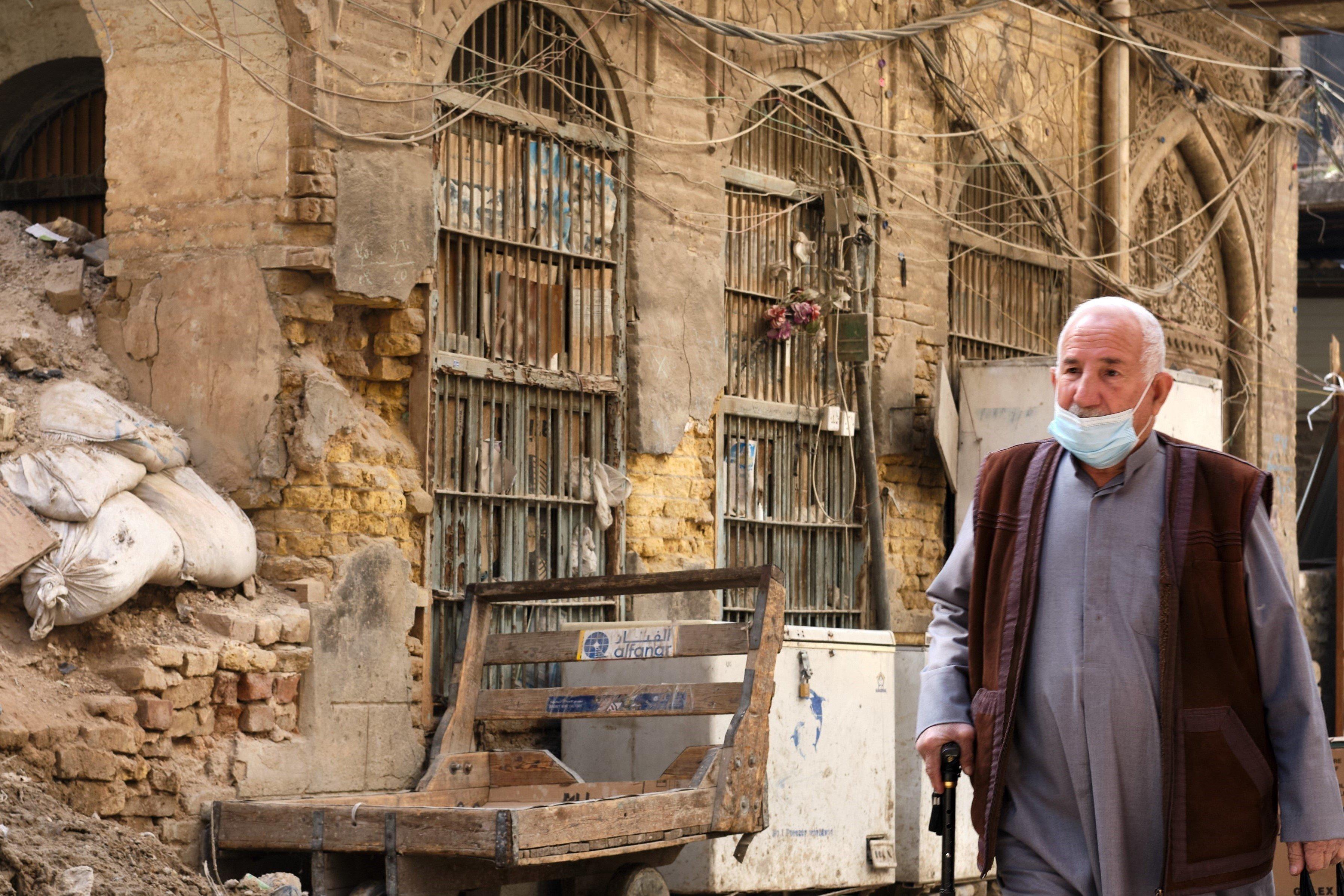 An Iraqi man walks the streets of Baghdad on 25 January, 2021 (Nabil Salih)