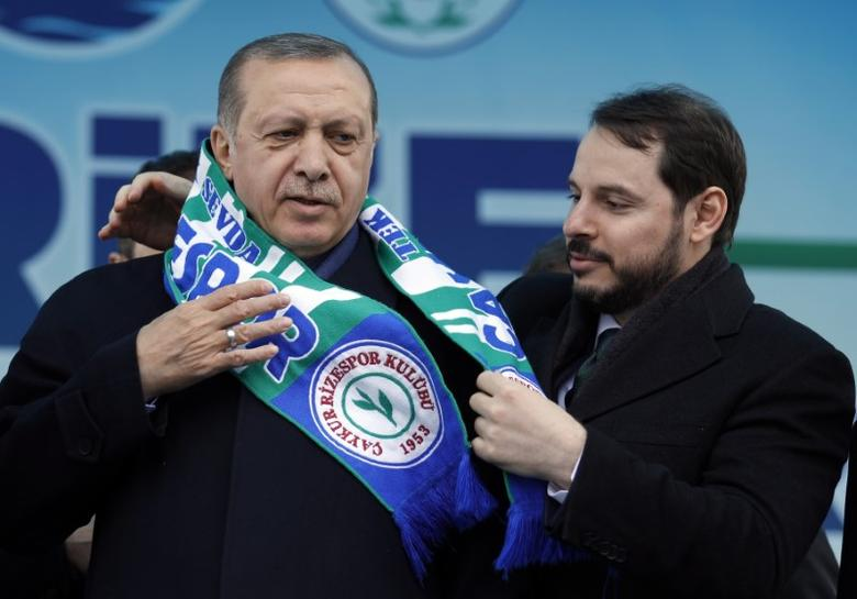 Erdogan receives a scarf of Caykur Rizespor from Albayrak during a rally for the presidential referendum in the Black Sea city of Rize inn 2017 (Reuters)