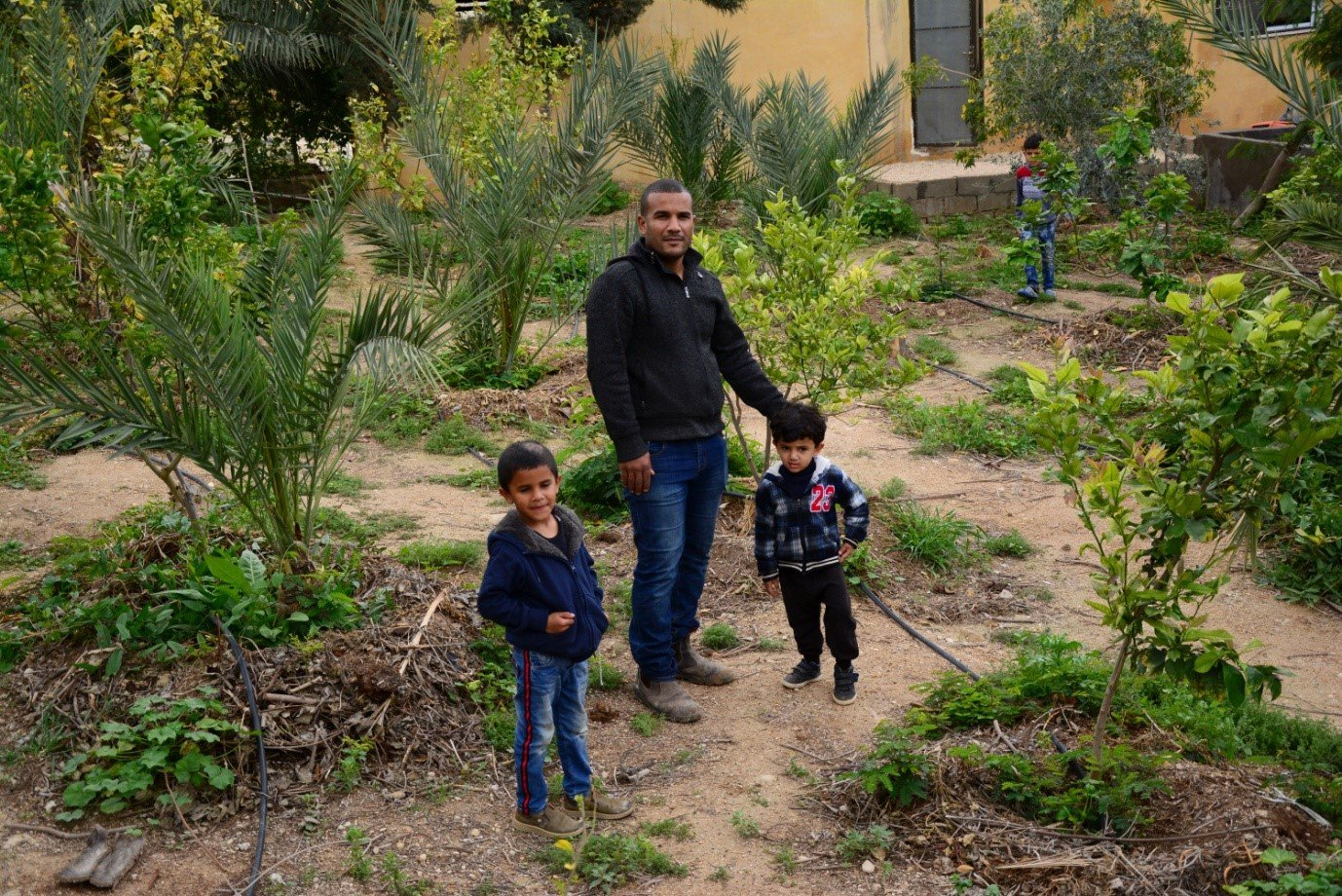 Hayel Abu Yahya and his family manage Greening the Desert's farm. (Marta Vidal/MEE)