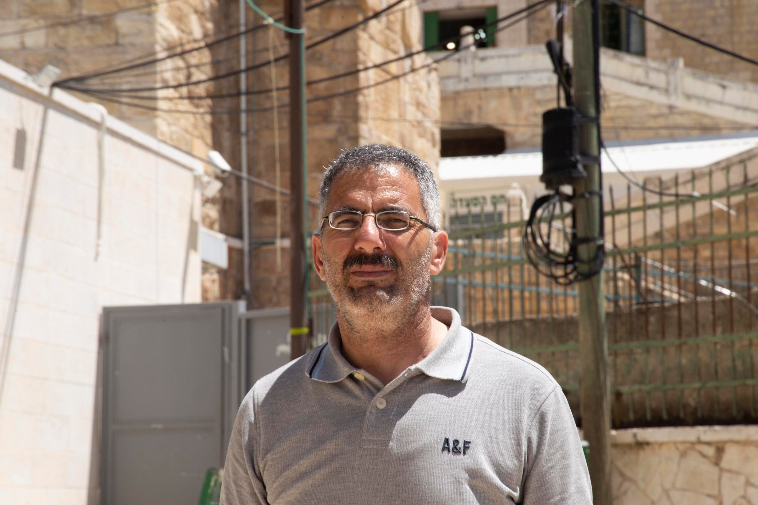 "For activist Aref Jaber, the Ibrahimi mosque case is ""not about religion, it's not about Muslims versus Jews. At the end of the day, this boils down to a political issue."" (MEE/Akram al-Waraa)"
