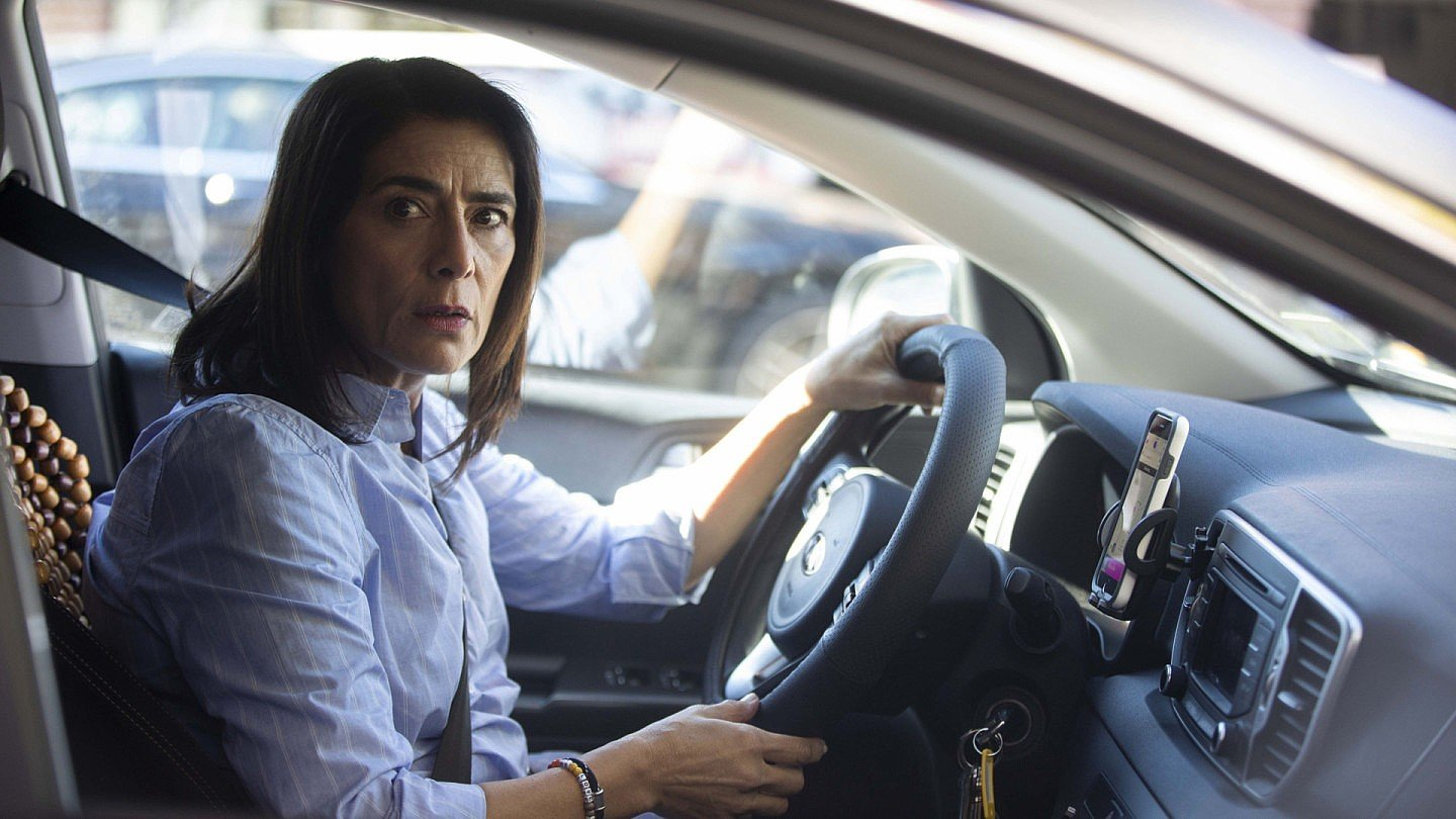 Ramy's mother, as played Hiam Abbass, briefly breaks out of her static life when she works as a taxi driver (Hulu)by Hulu  ​