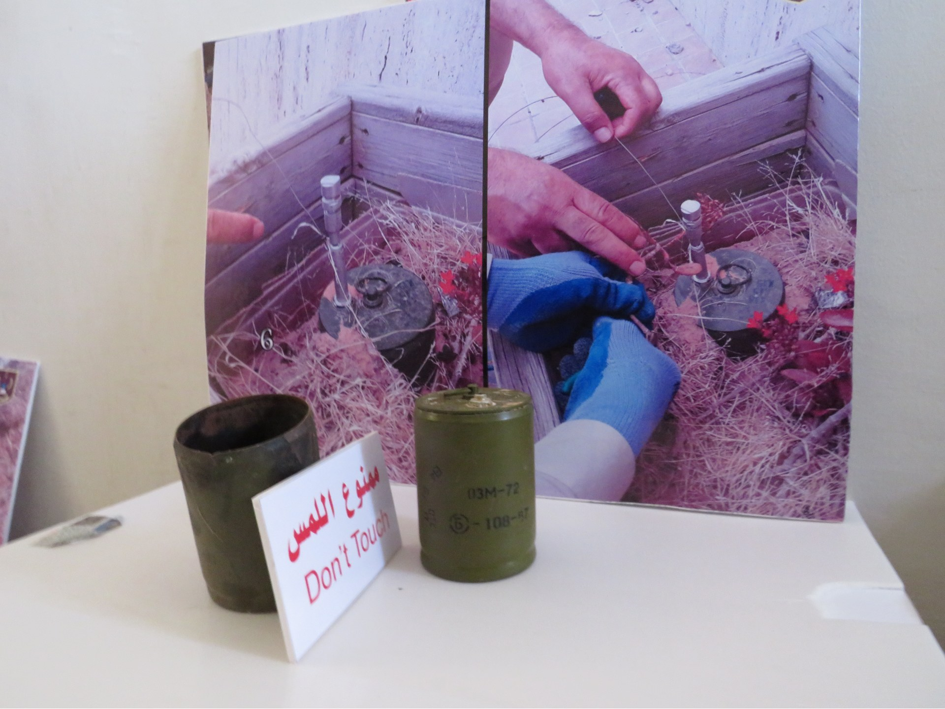 OZM-72 mines in front of photographs of one of their model found in situ in Tripoli (MEE/Daniel Hilton)